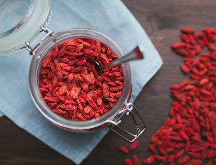 Glass container with goji berries and spoon