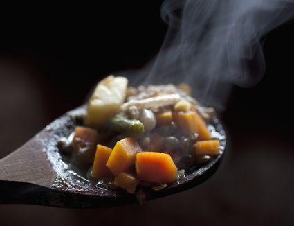 Vegetable stew on a wooden spoon