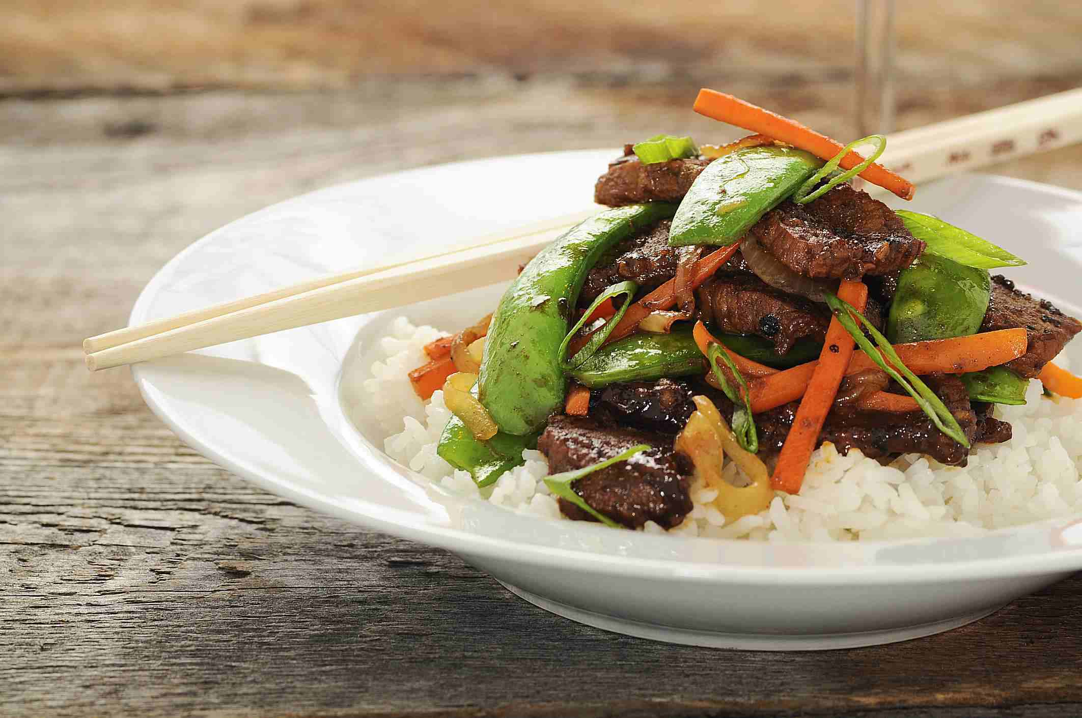Beef and vegetable stir fry in a bowl of rice