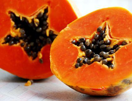 Half cut fresh papaya with star shape heart with seeds