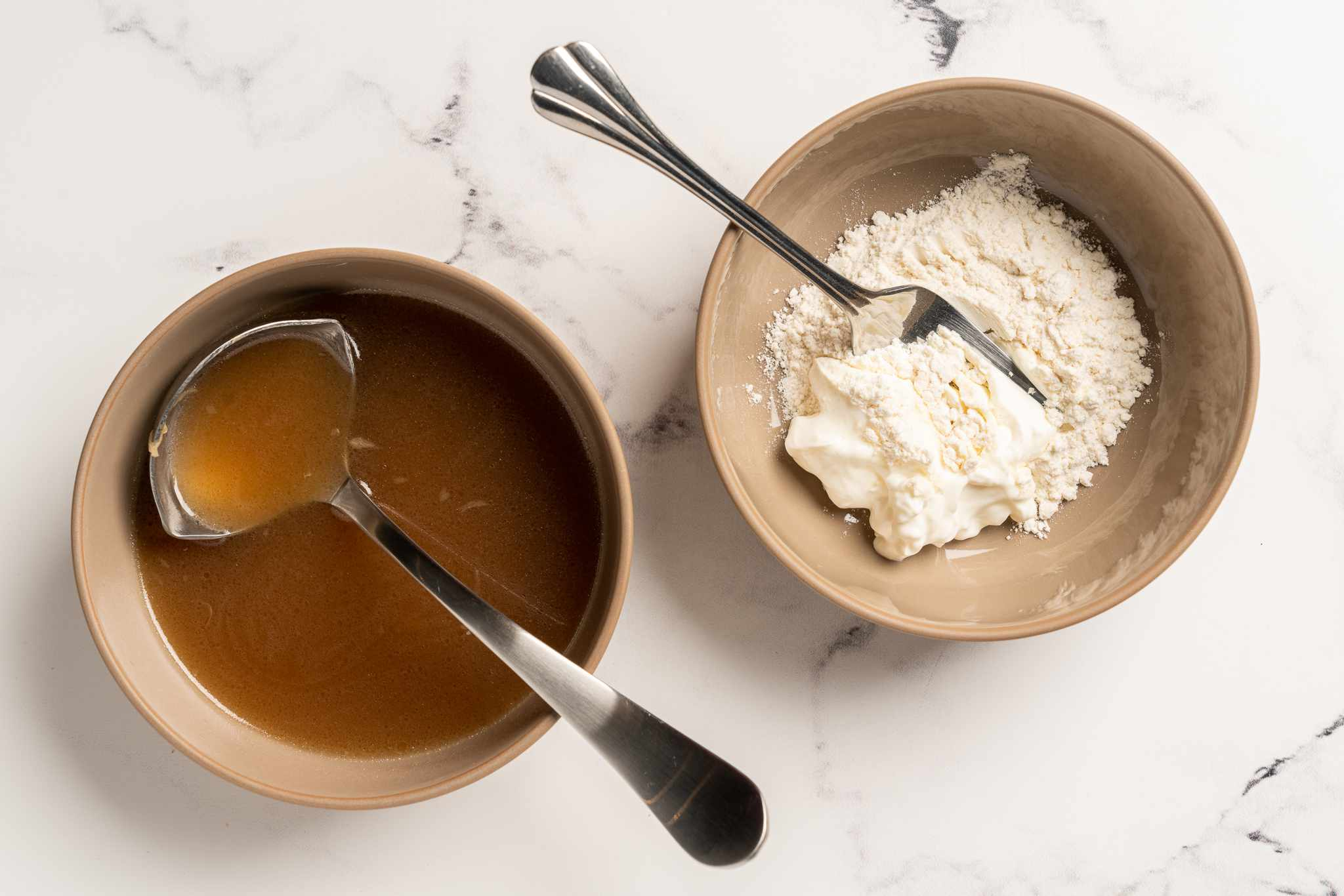 flour and sour cream in a bowl, soup in a bowl
