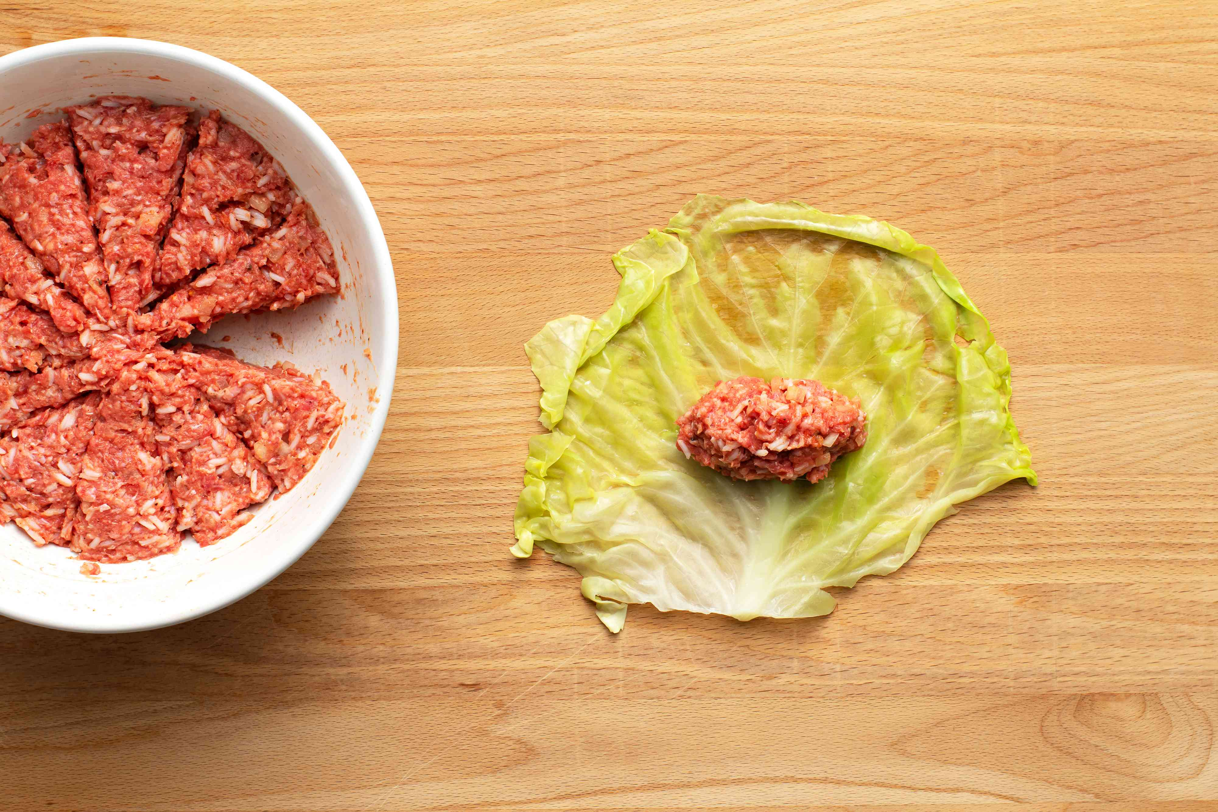 Place meat on the cabbage leaf