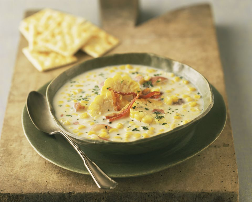 Corn chowder in bowl with crackers