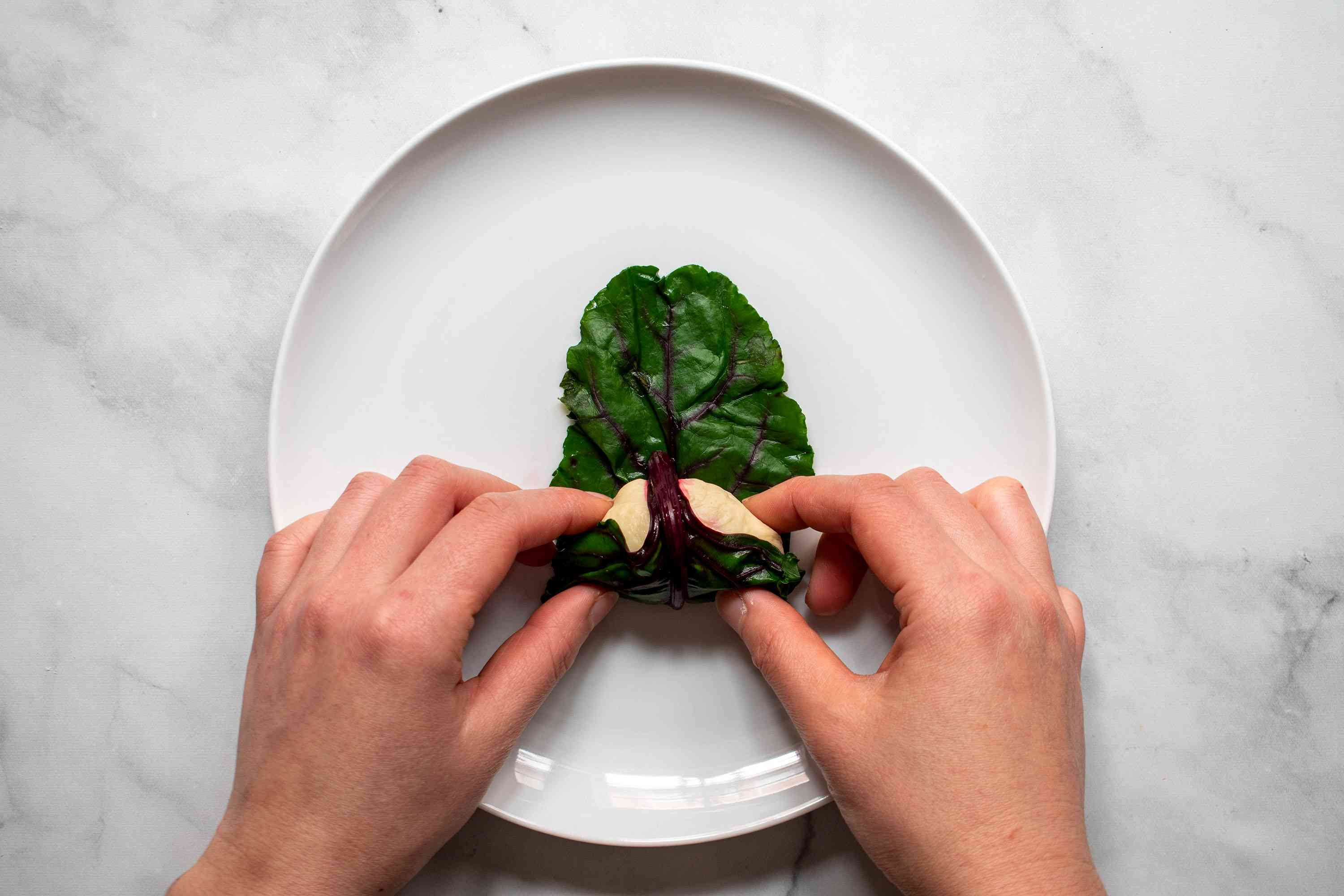 roll the beet leaf around the dough
