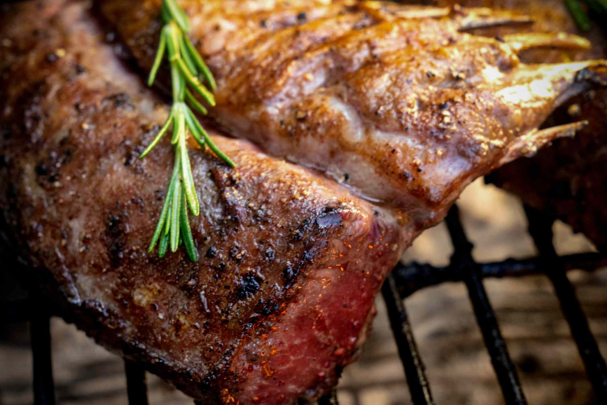 Lamb chops grilling with herbs