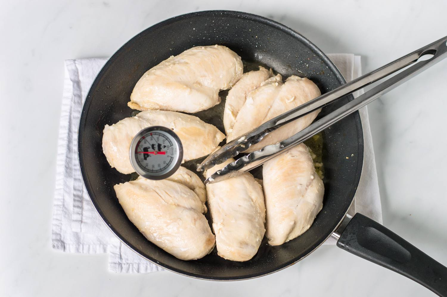 Cooking chicken breasts in skillet