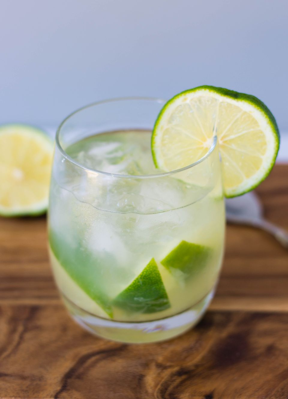 Caipirinha cocktail on the rocks with lime