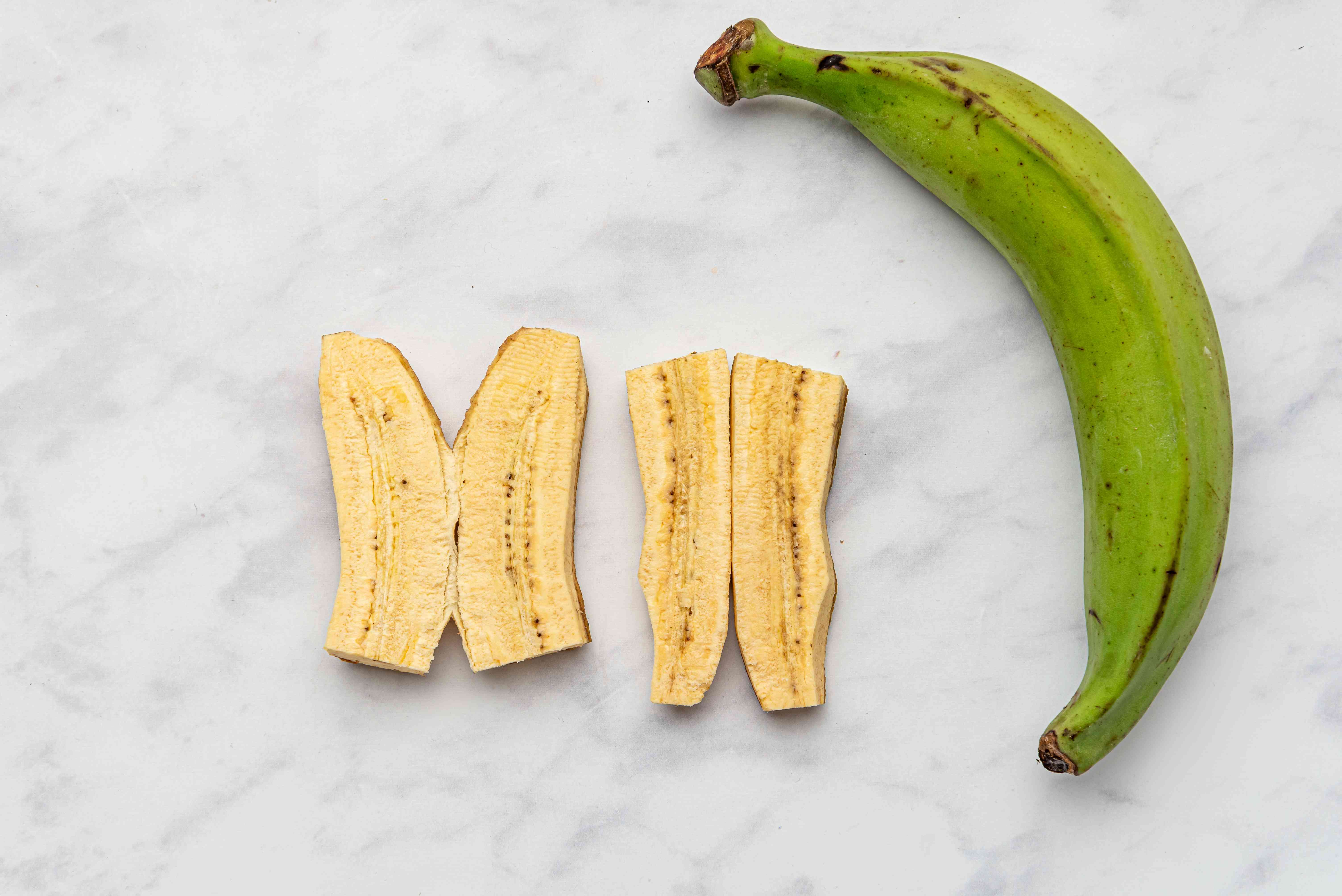 Peel the plantains, cut them in half, then cut each half lengthwise
