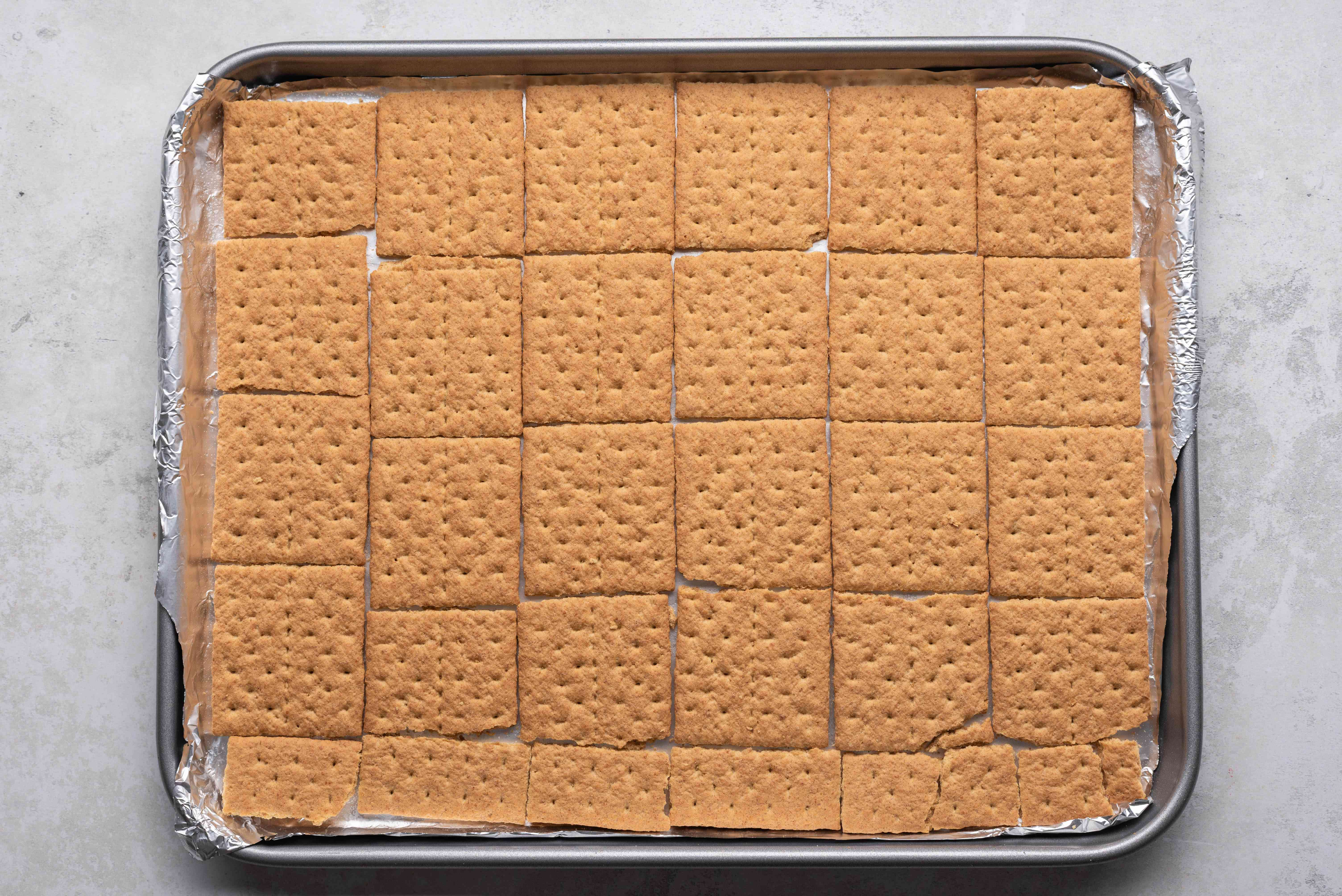 graham crackers in a single layer on the baking sheet