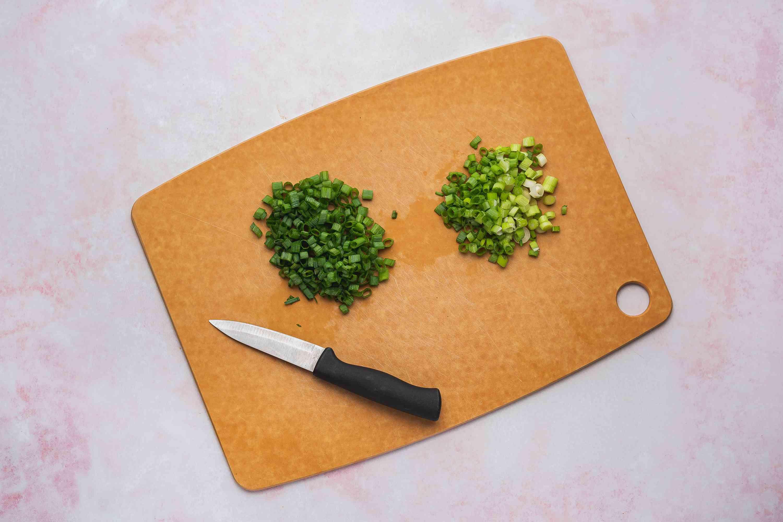 Sliced green onions on a cutting board