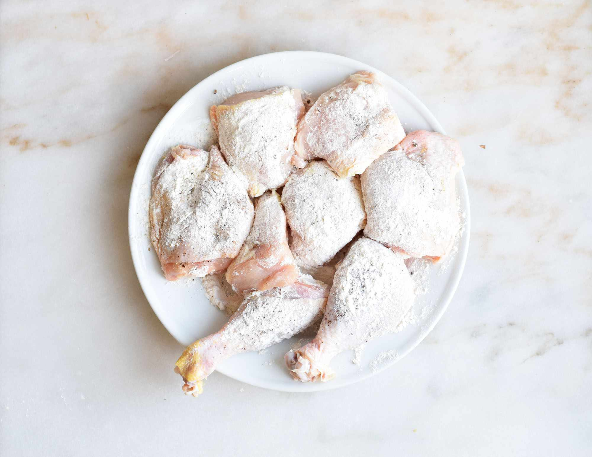 Chicken pieces coated in flour