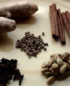 Masala Chai spices, including ginger, peppercorns, cinnamon, cloves and cardamom