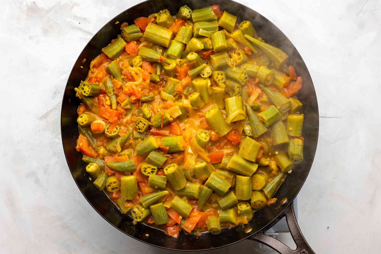 okra mixture cooking in a pan