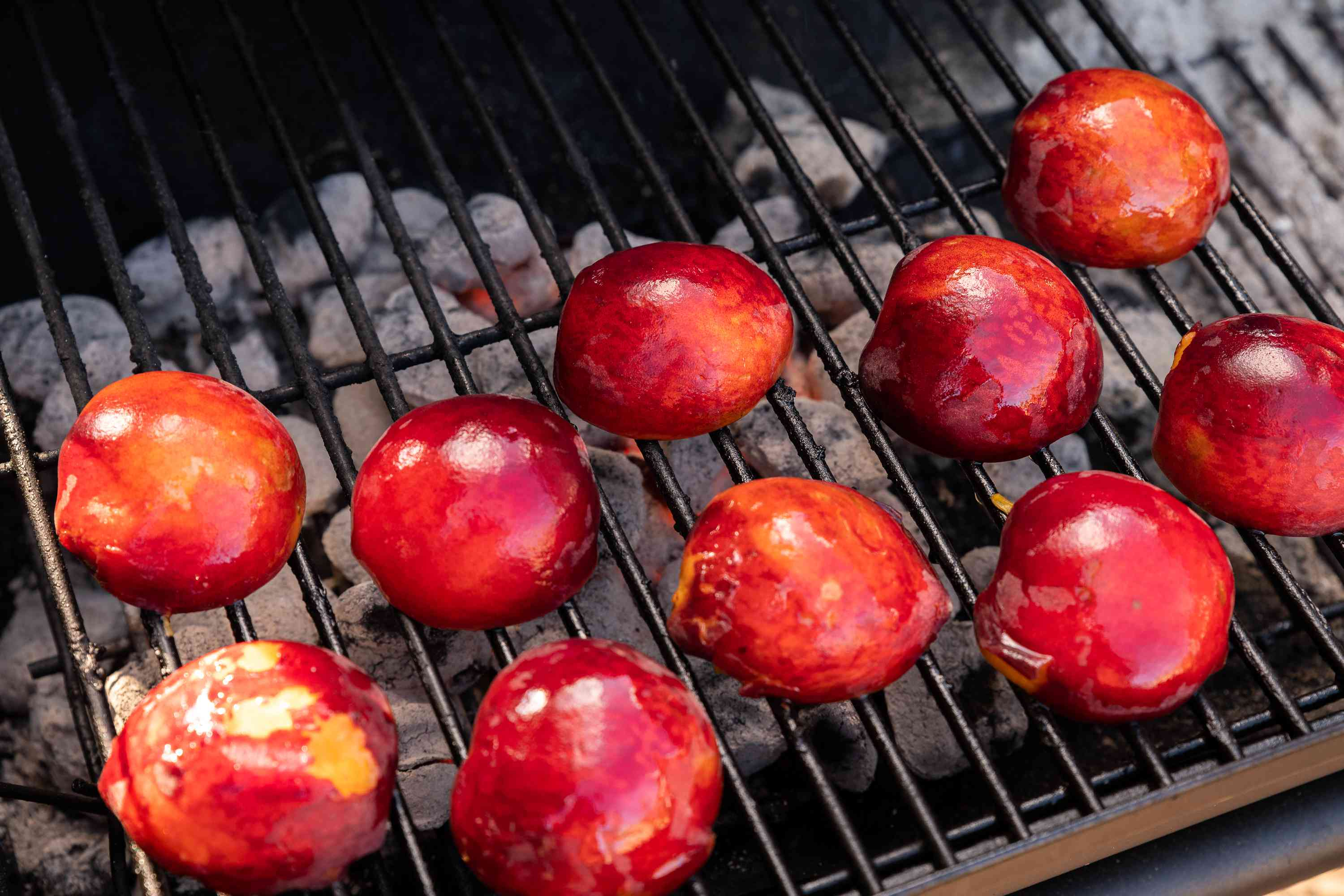 Set the oiled peaches cut side down on the medium hot grill