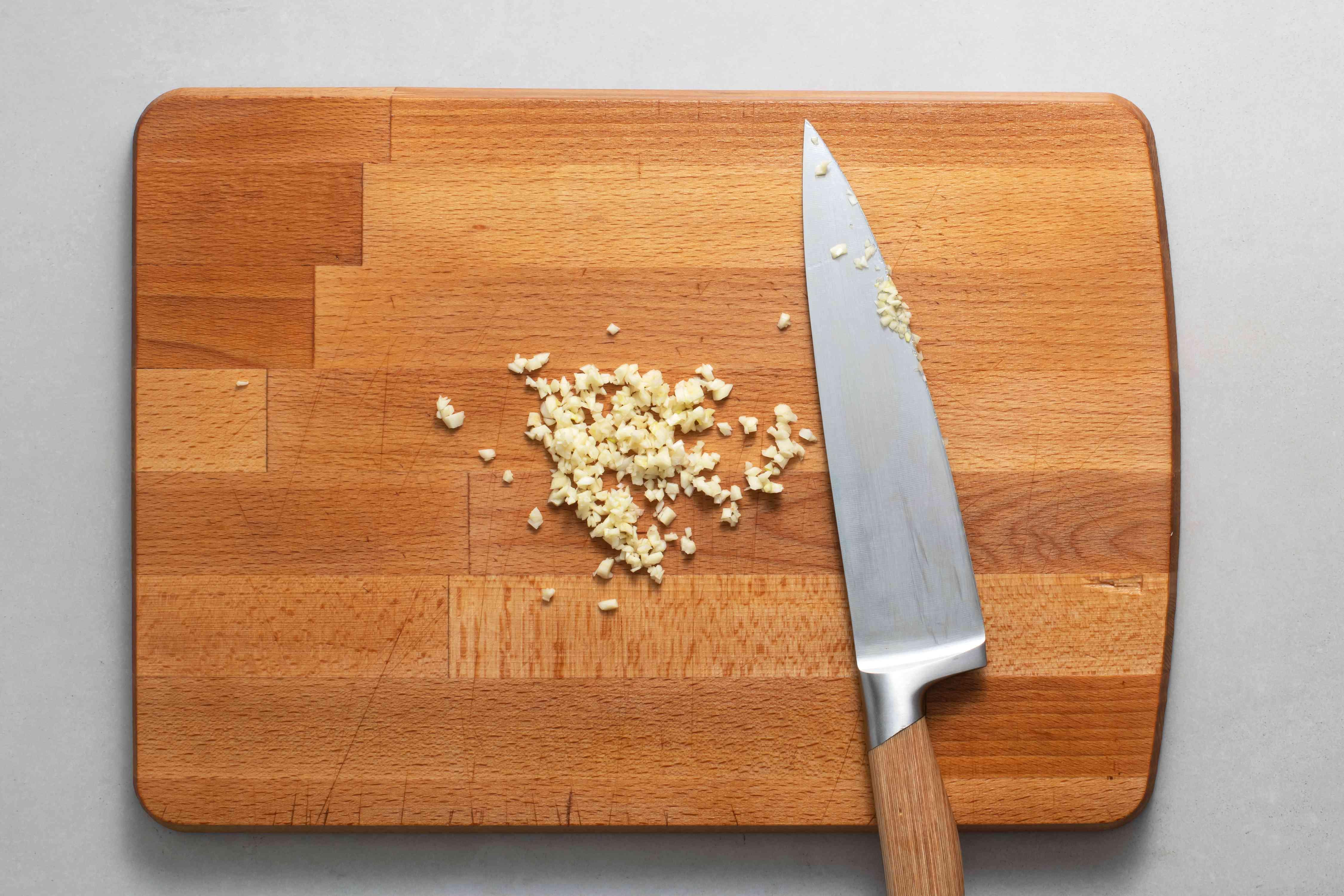 chopped garlic on a cutting board
