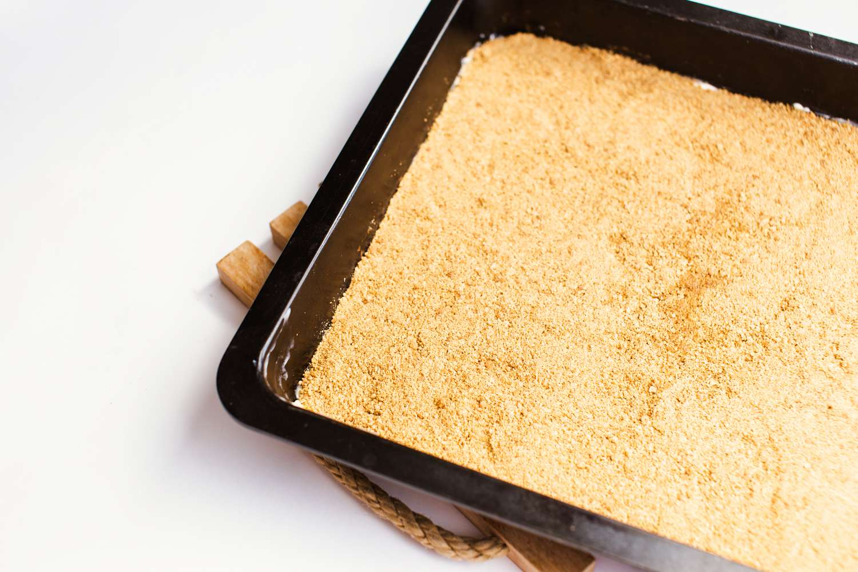 Sprinkle graham cracker crumbs evenly