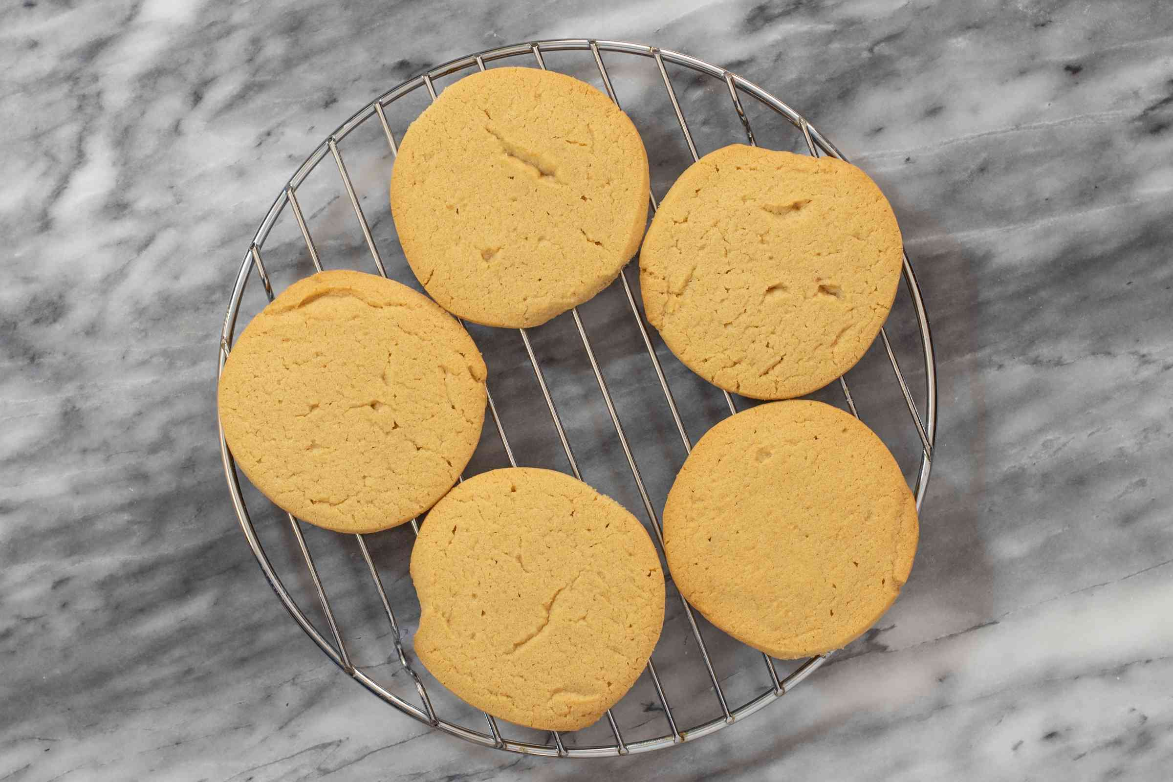 Peanut butter icebox cookies on a cooling rack.