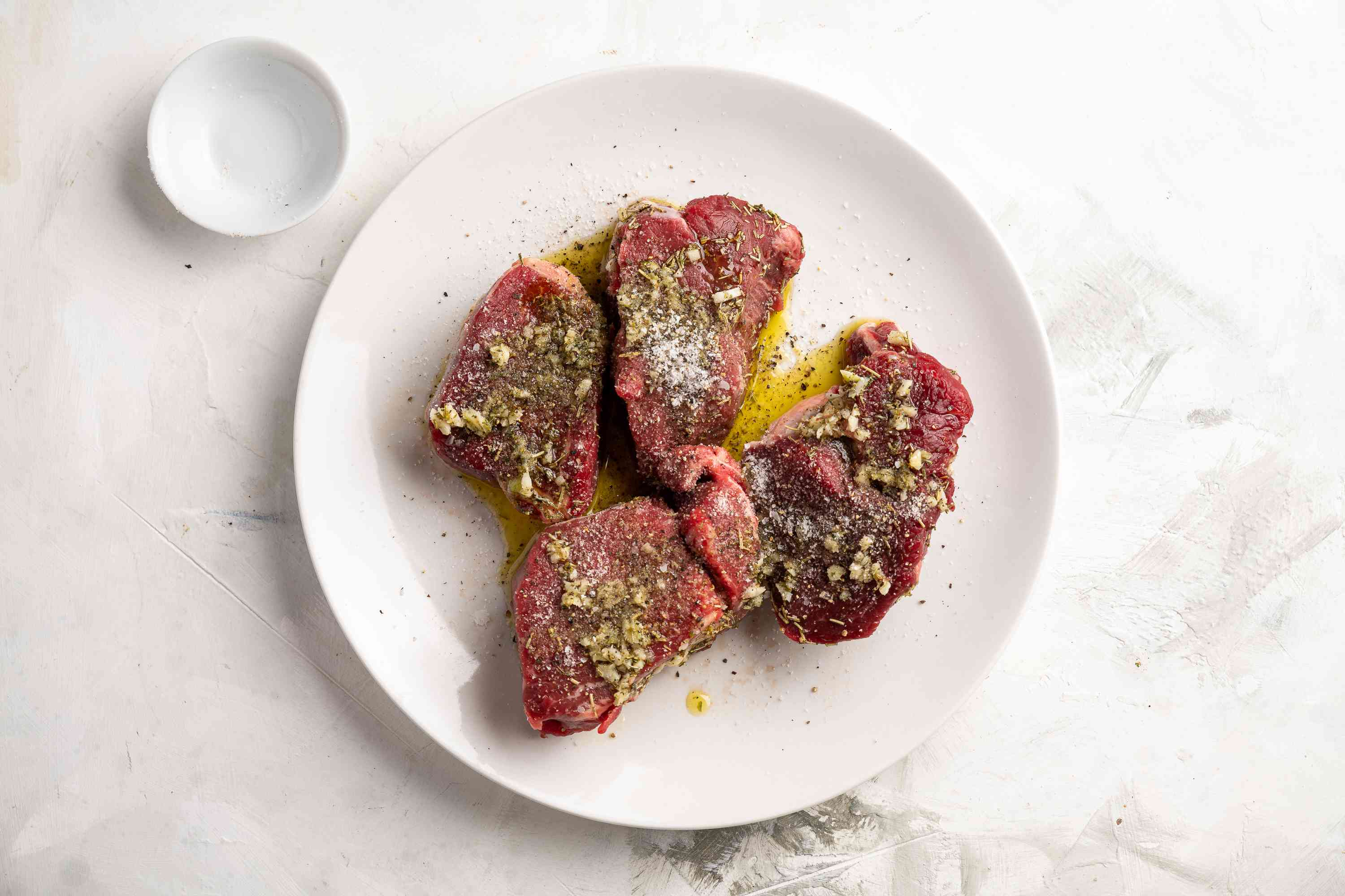 Remove the steaks from the fridge, and season both sides with salt and pepper