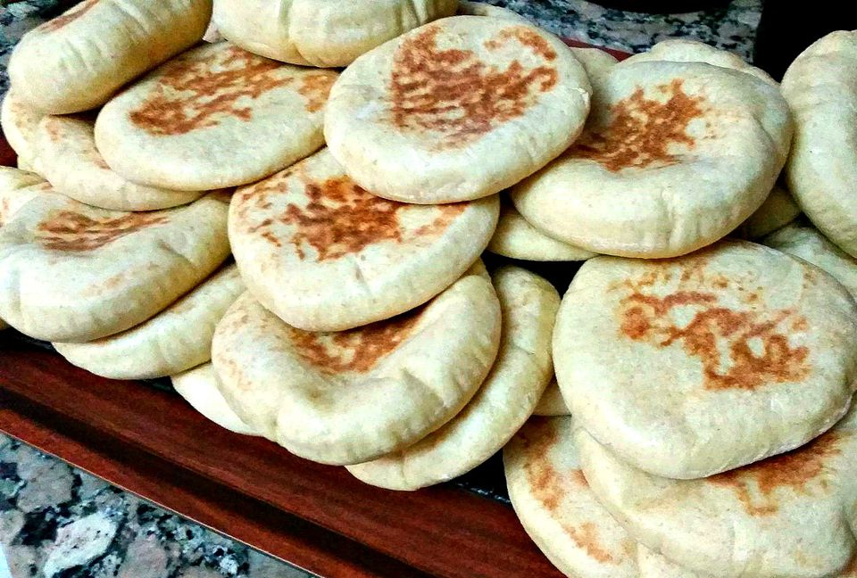 Moroccan pita bread stacked on rack