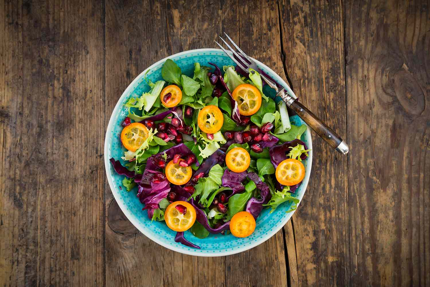 Mixed salad with kumquat, red cabbage and pomegranate seeds