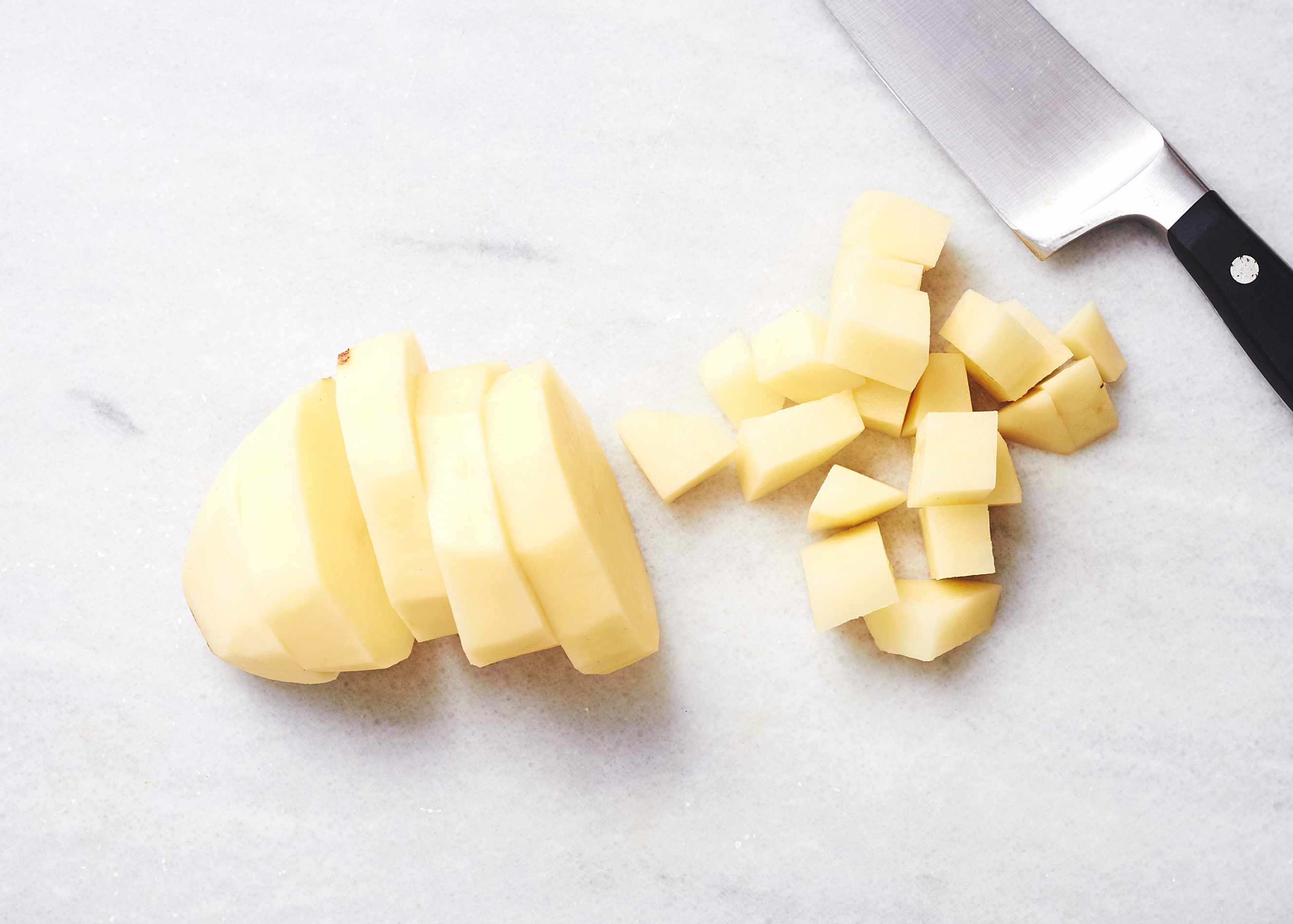 Peel the potato and cut it into pieces