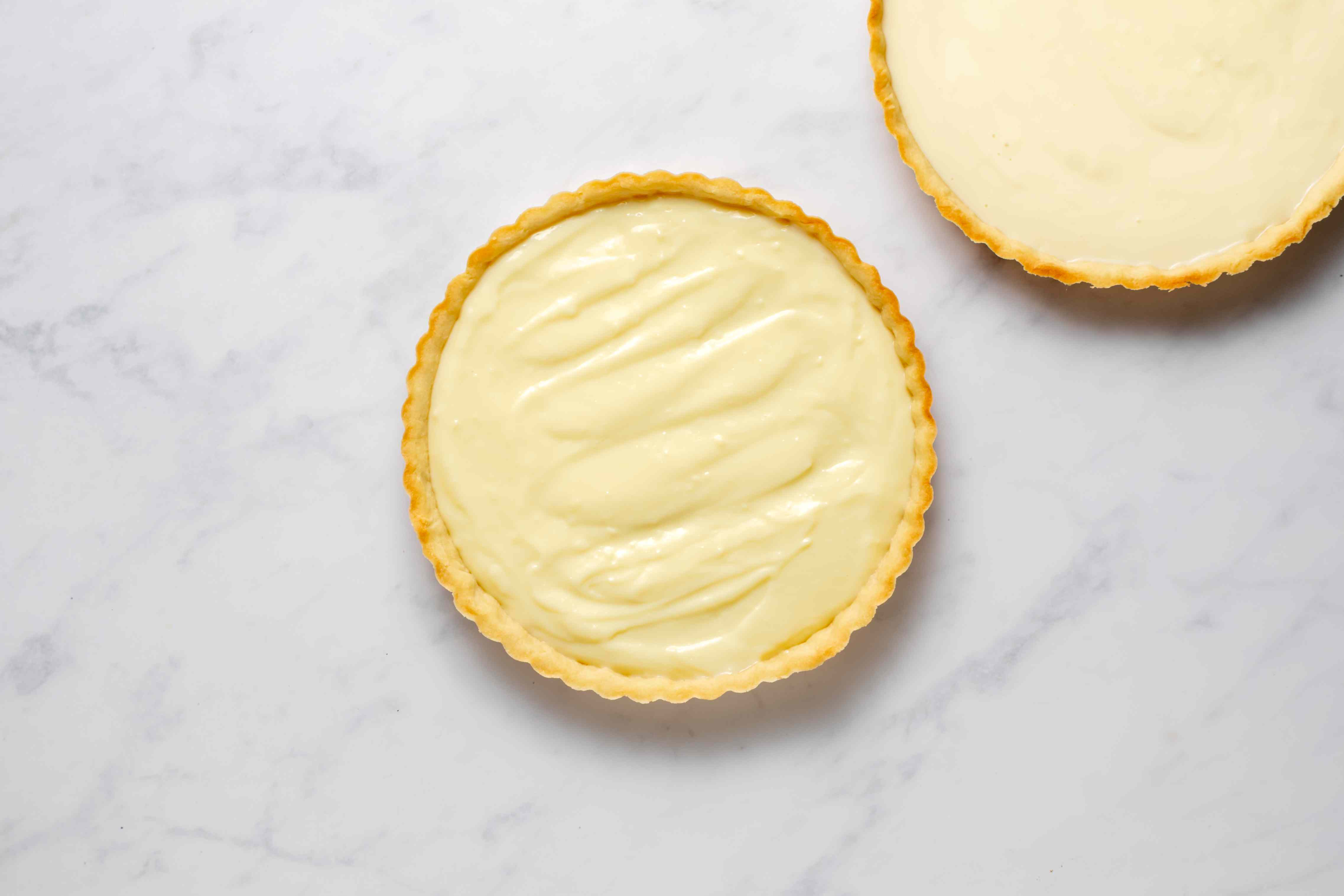 tart crust filled with pastry cream
