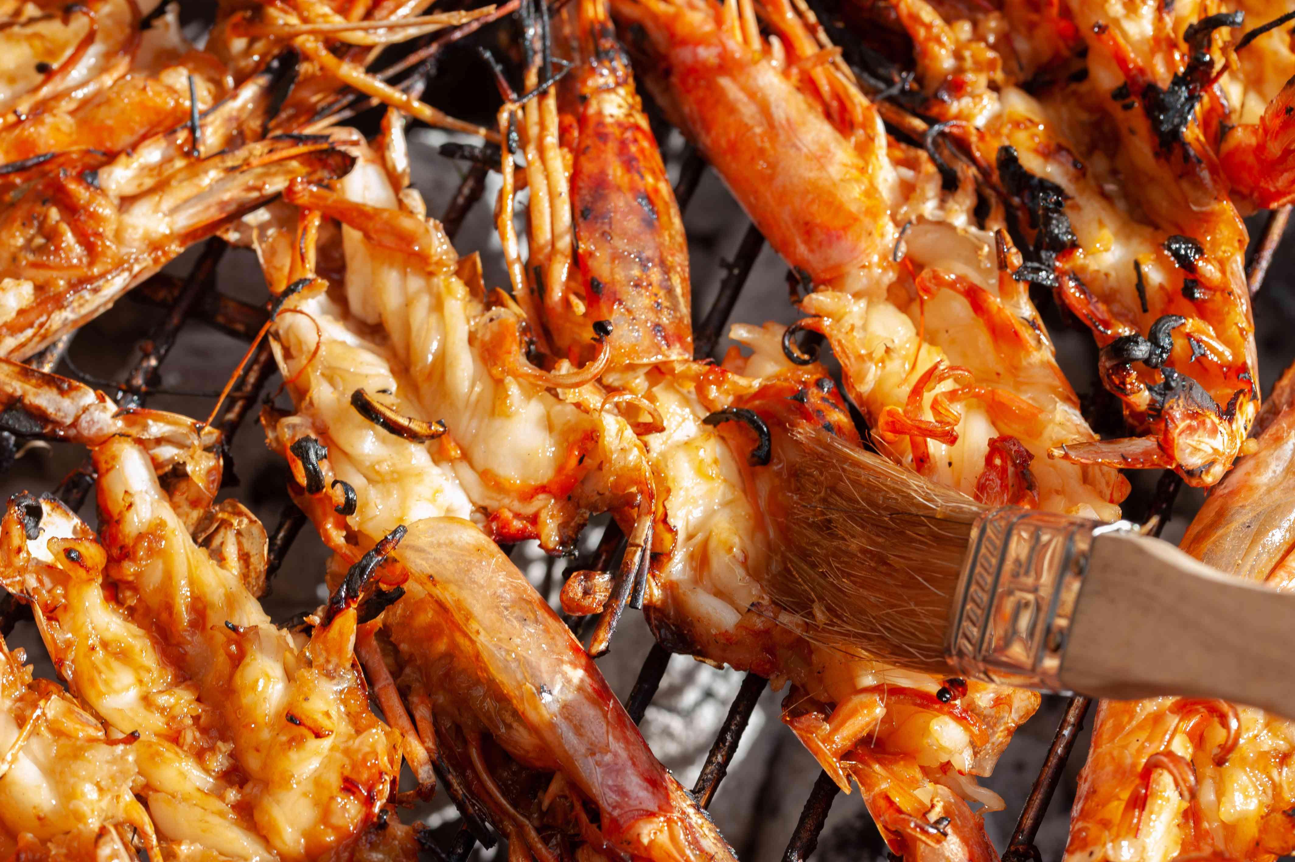 Basting prawns with BBQ brush