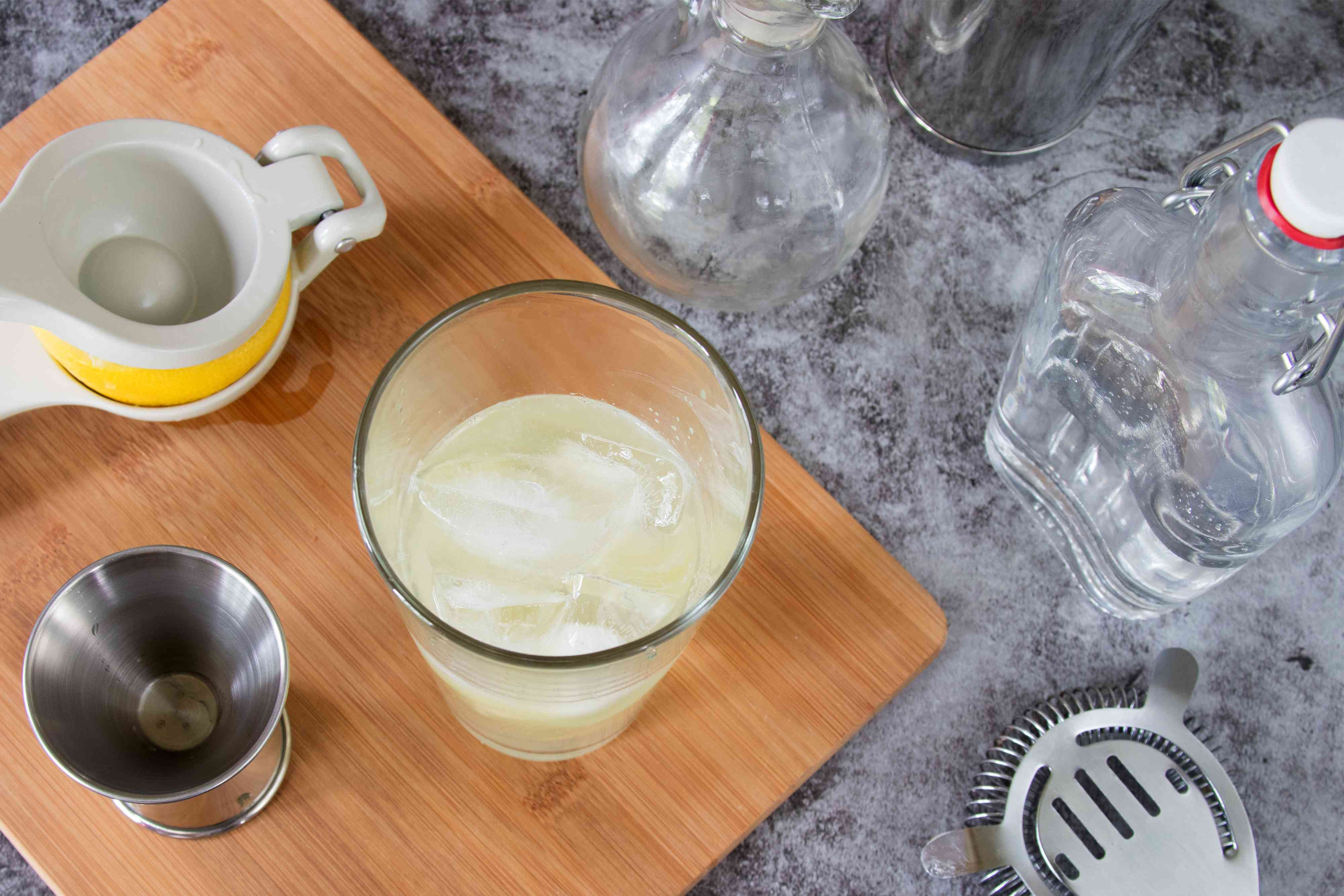 Mixing a Classic Gin Fizz in a Cocktail Shaker