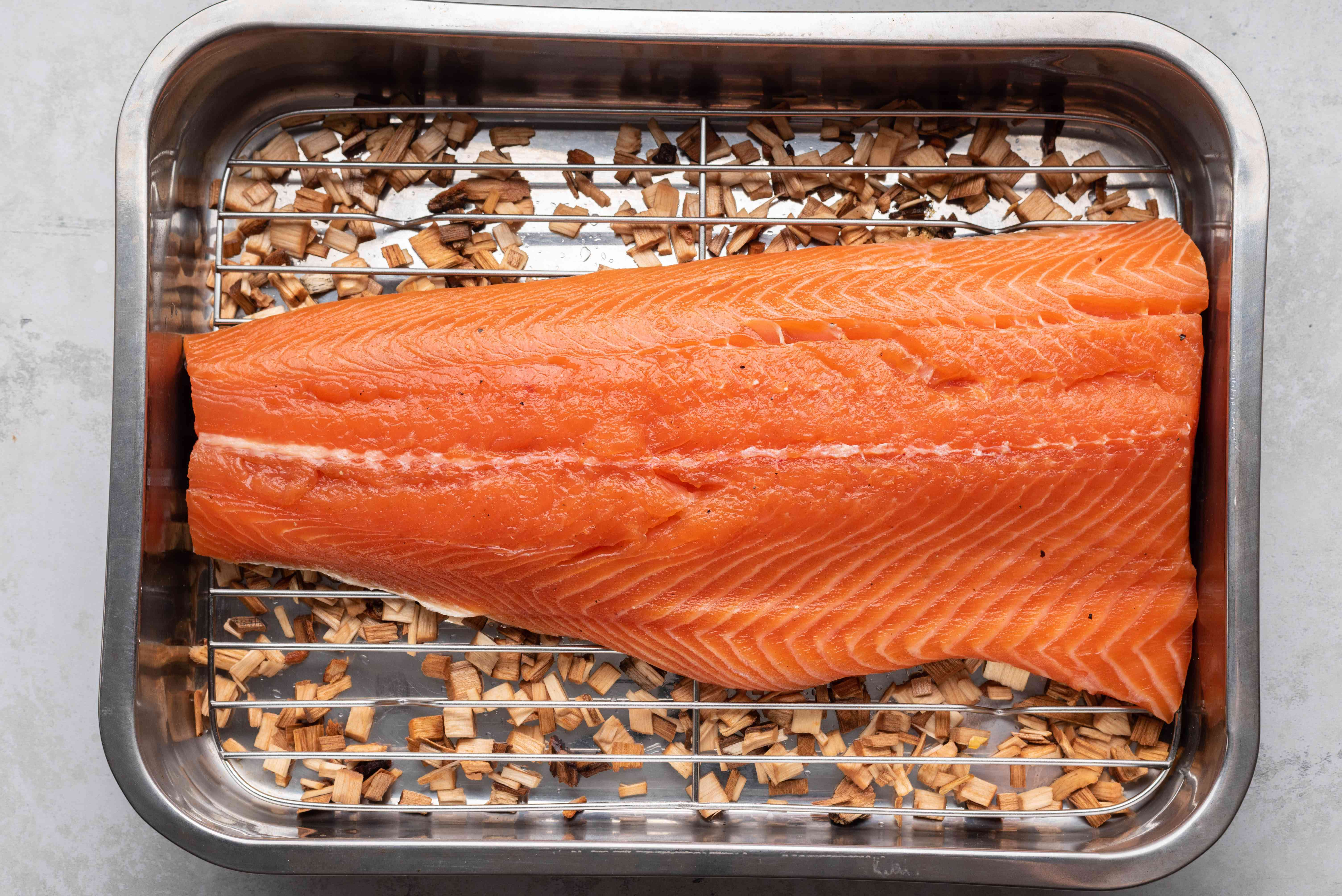 salmon on a rack in a roasting pan