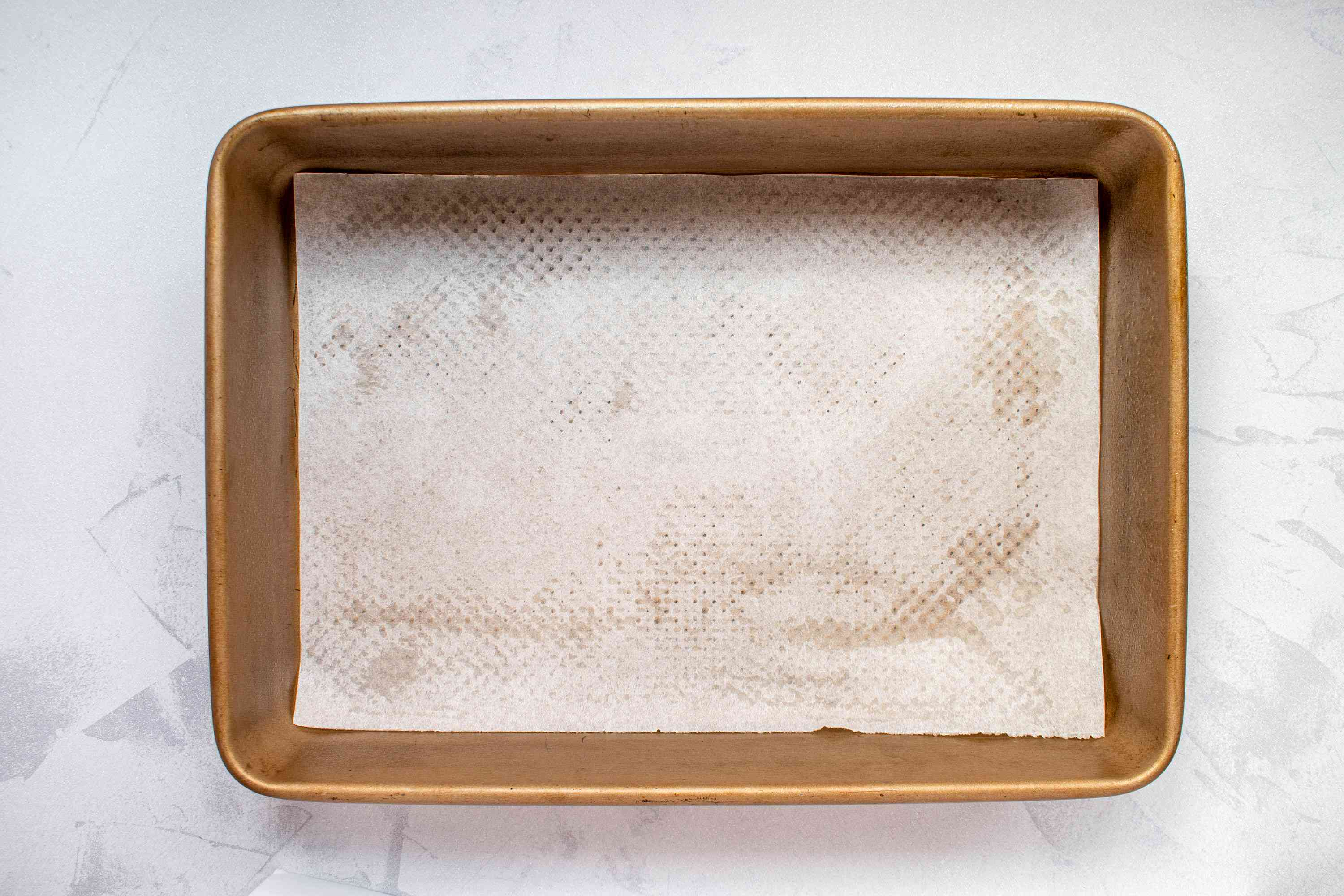 Greased baking pan lined with parchment paper
