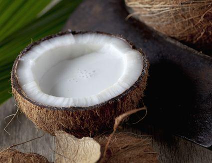 Coconut half with coconut milk
