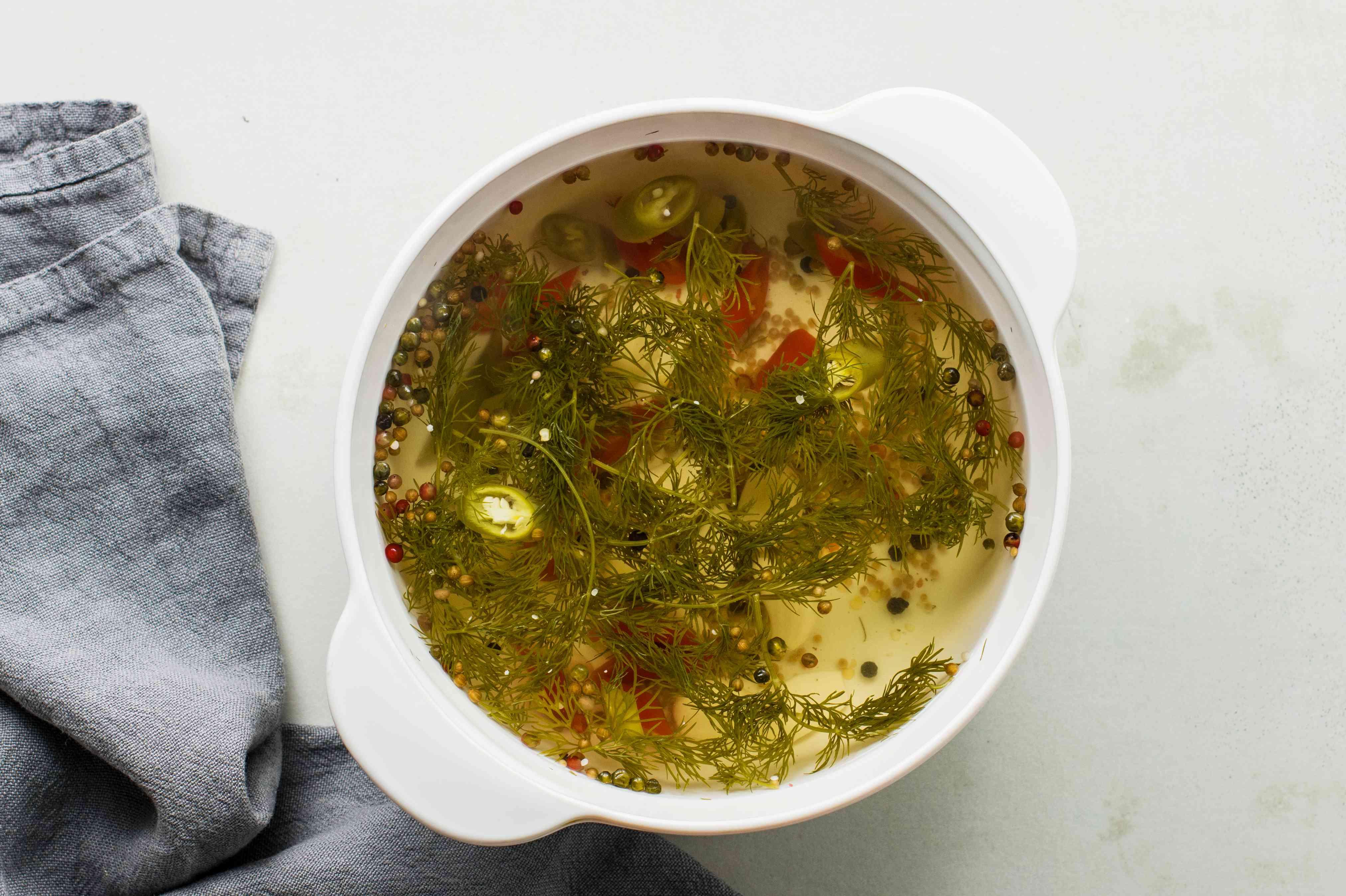 Combine vinegar, water, salt, sugar, and seasonings in pot