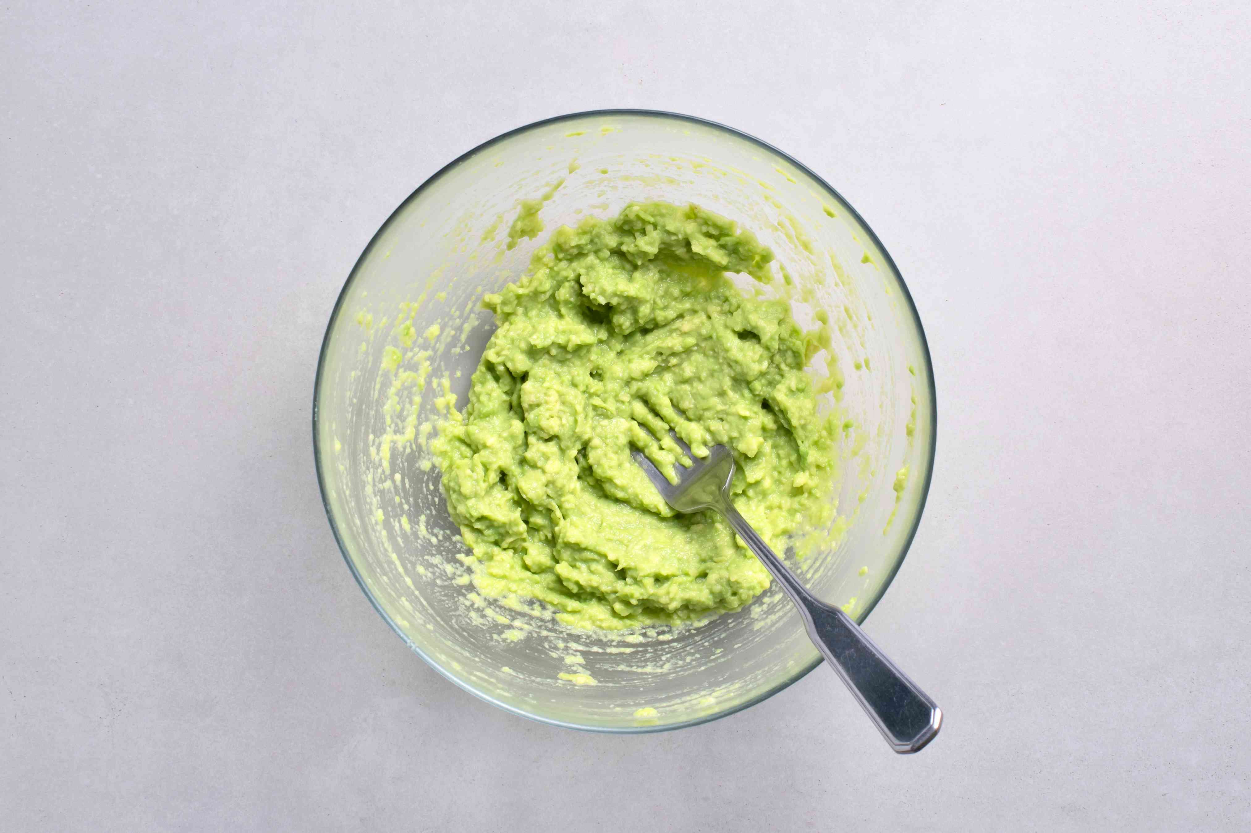 Avocado mashed in a bowl