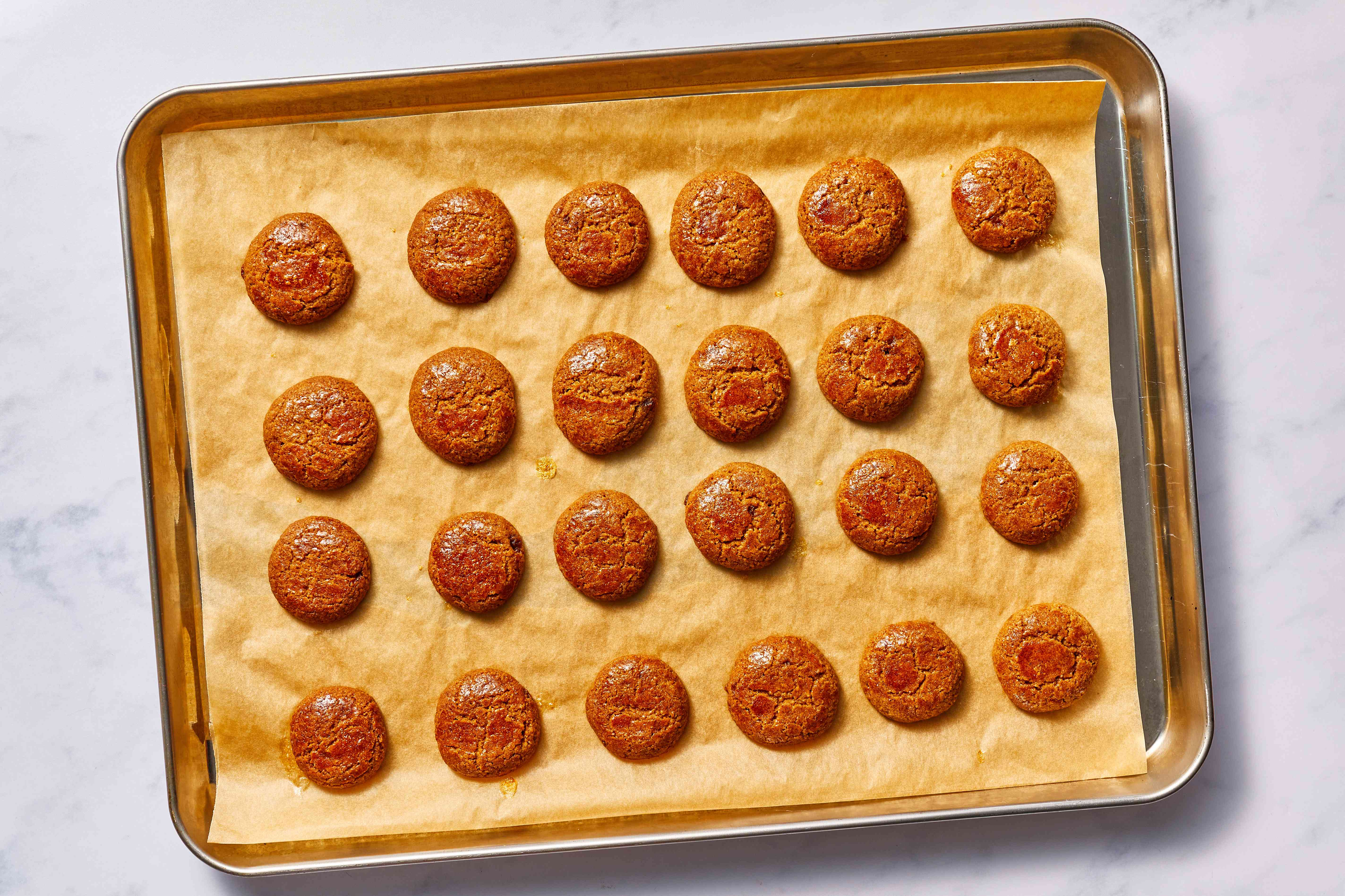 Traditional Kruidnoten Cookies—Dutch Ginger Nuts on a baking sheet