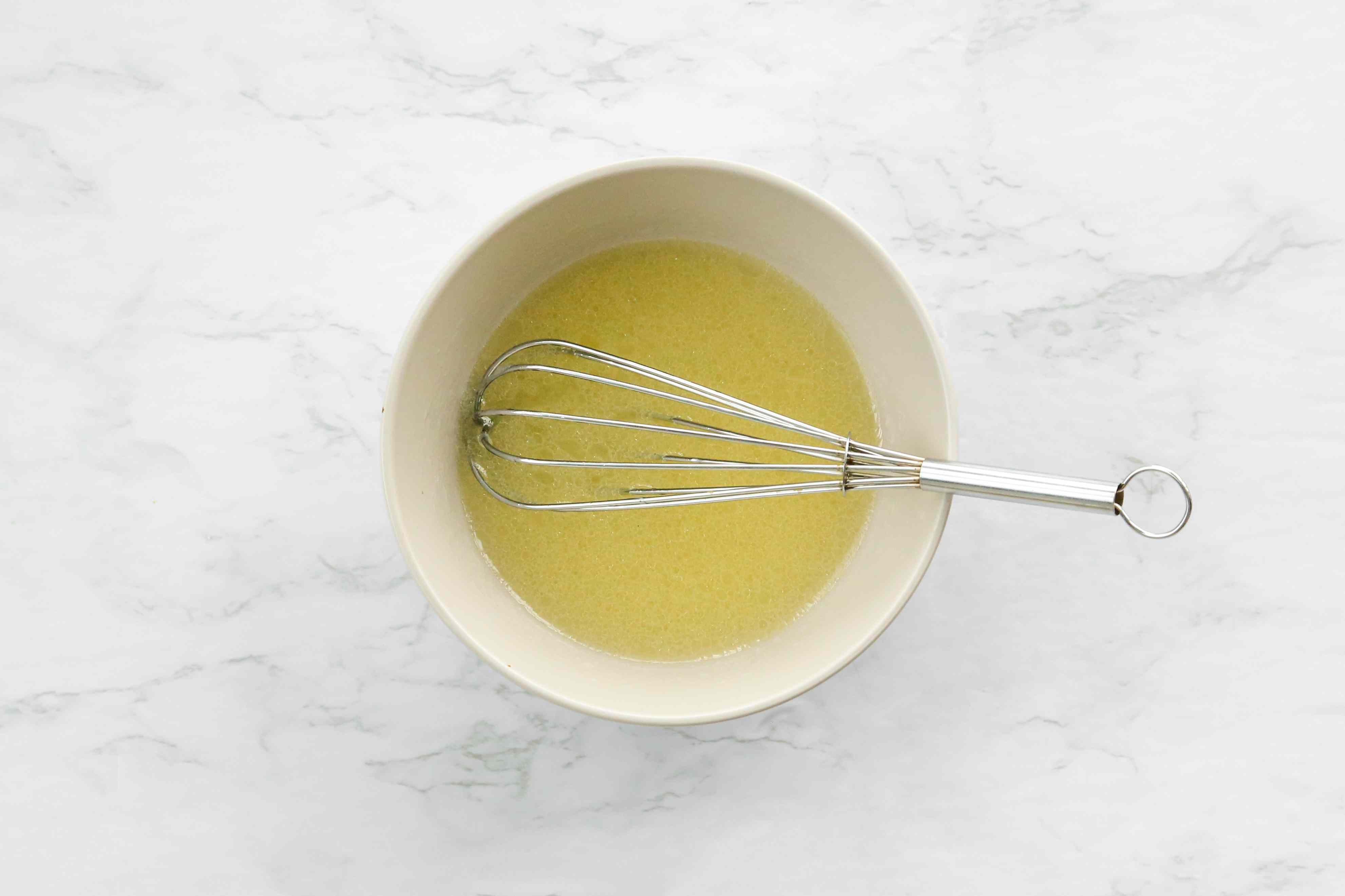 In a medium bowl, add the lemon juice and slowly whisk in the vegetable oil