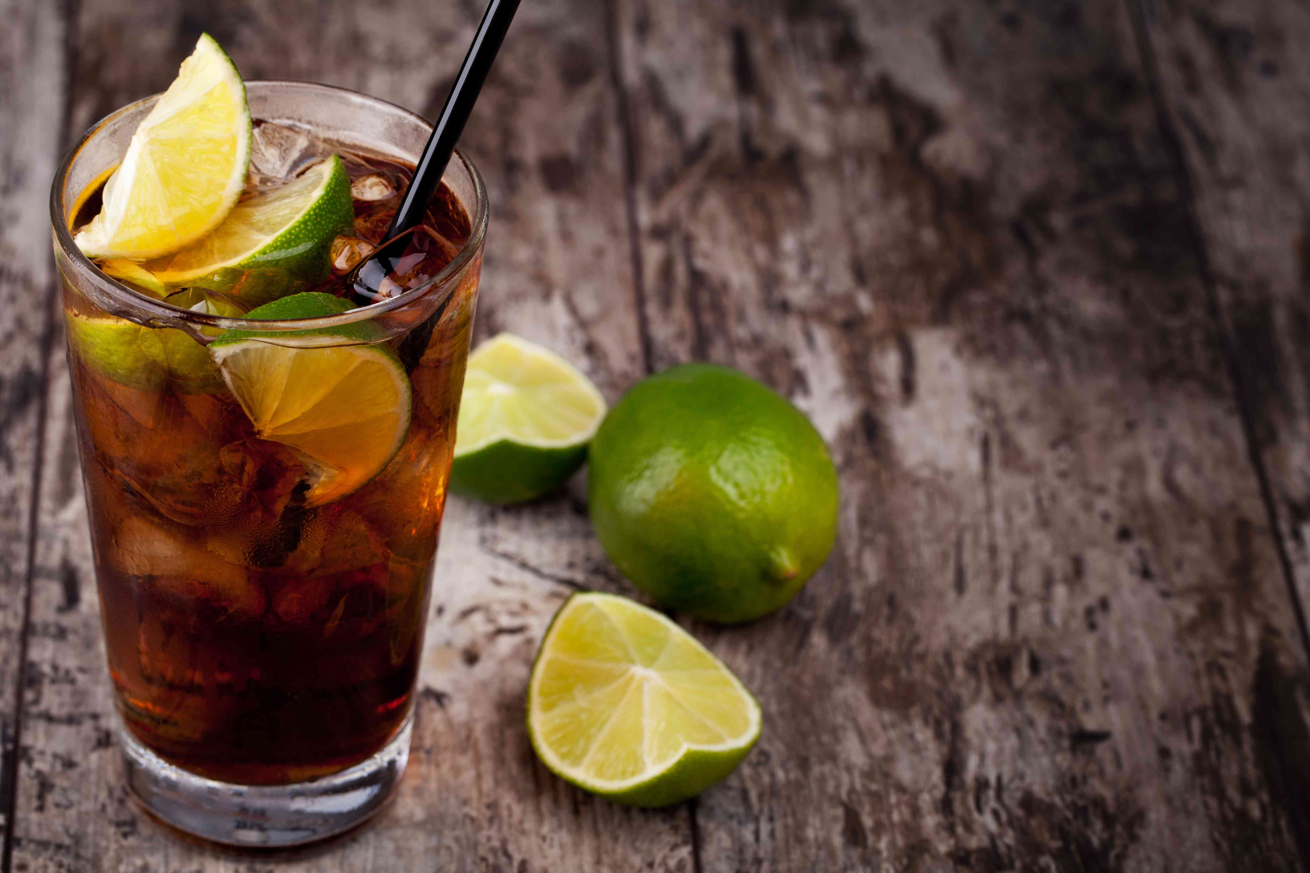 Cuba Libre drink placed on rustic table