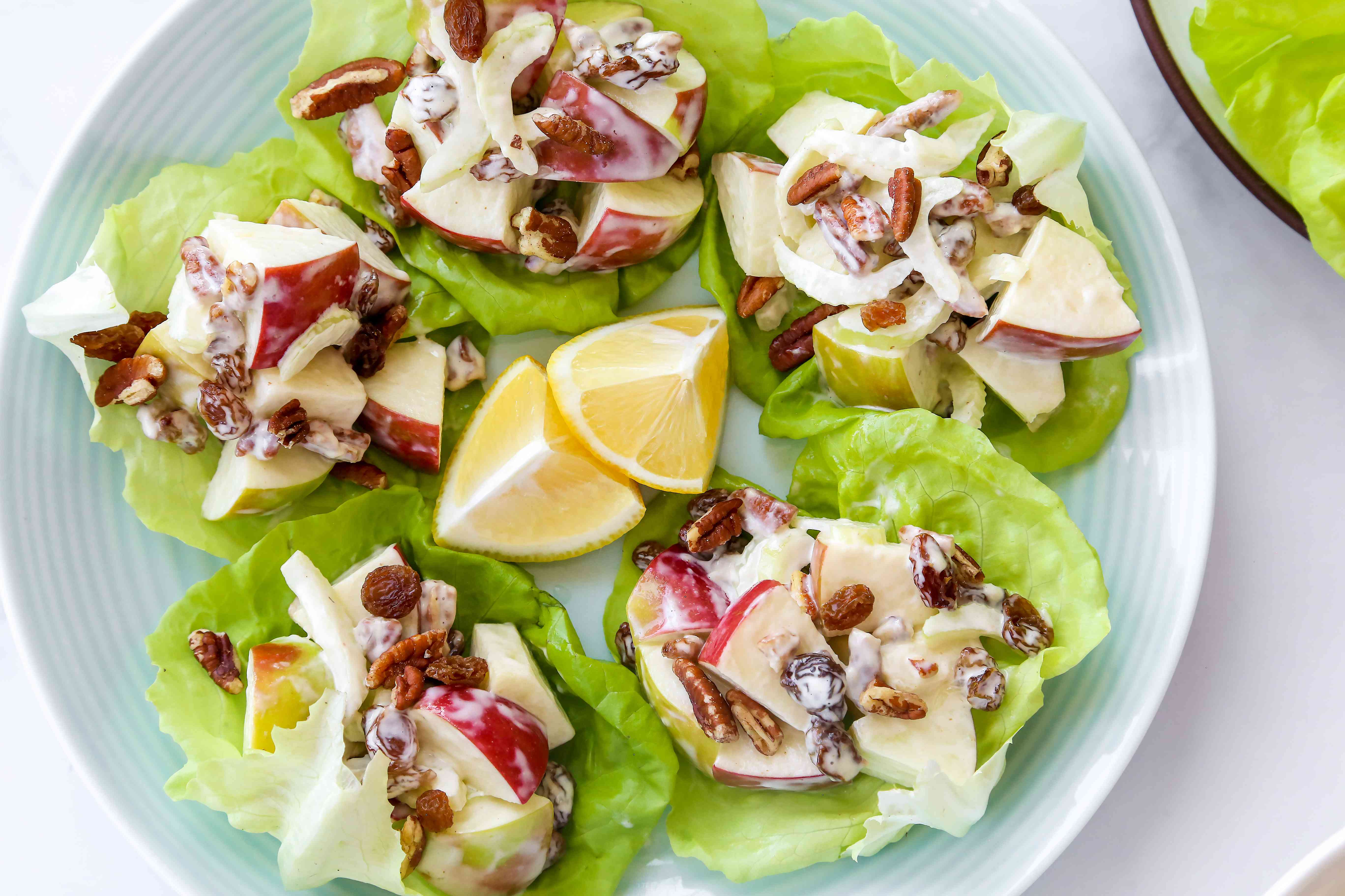 Apple Salad With Pecans and Raisins on a platter