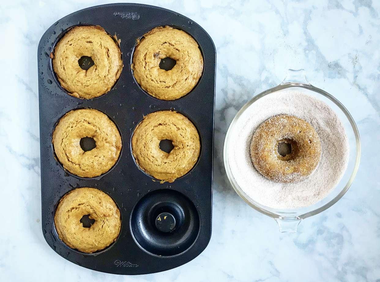 Pumpkin doughnuts in cinnamon sugar