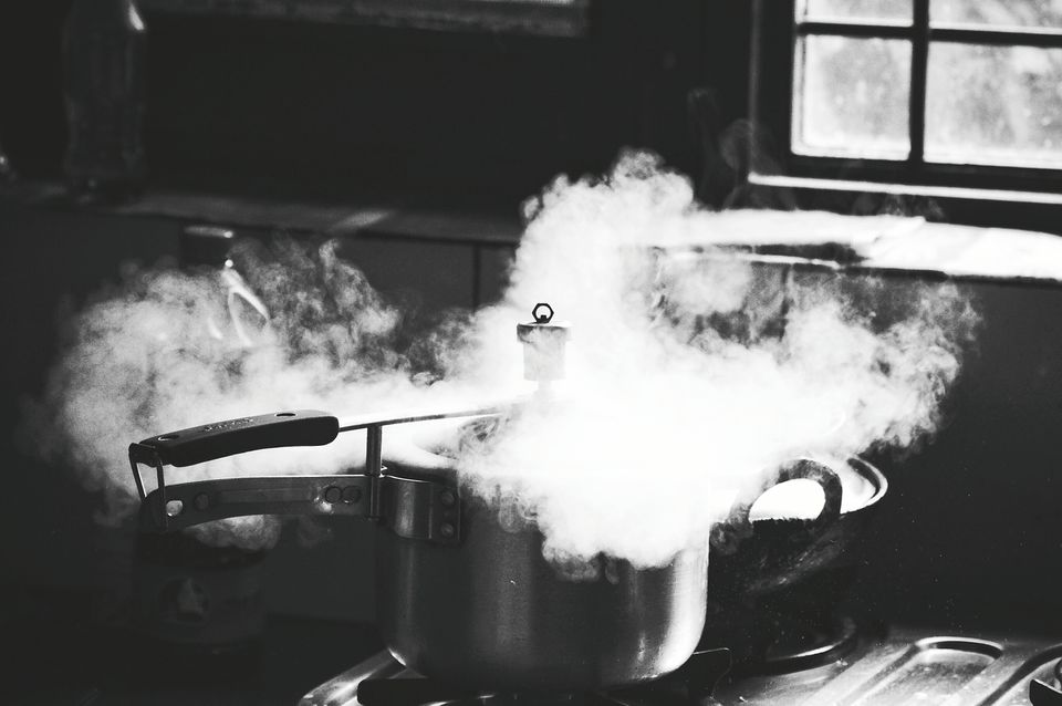 Close-Up Of Steam Releasing Through Pressure Cooker