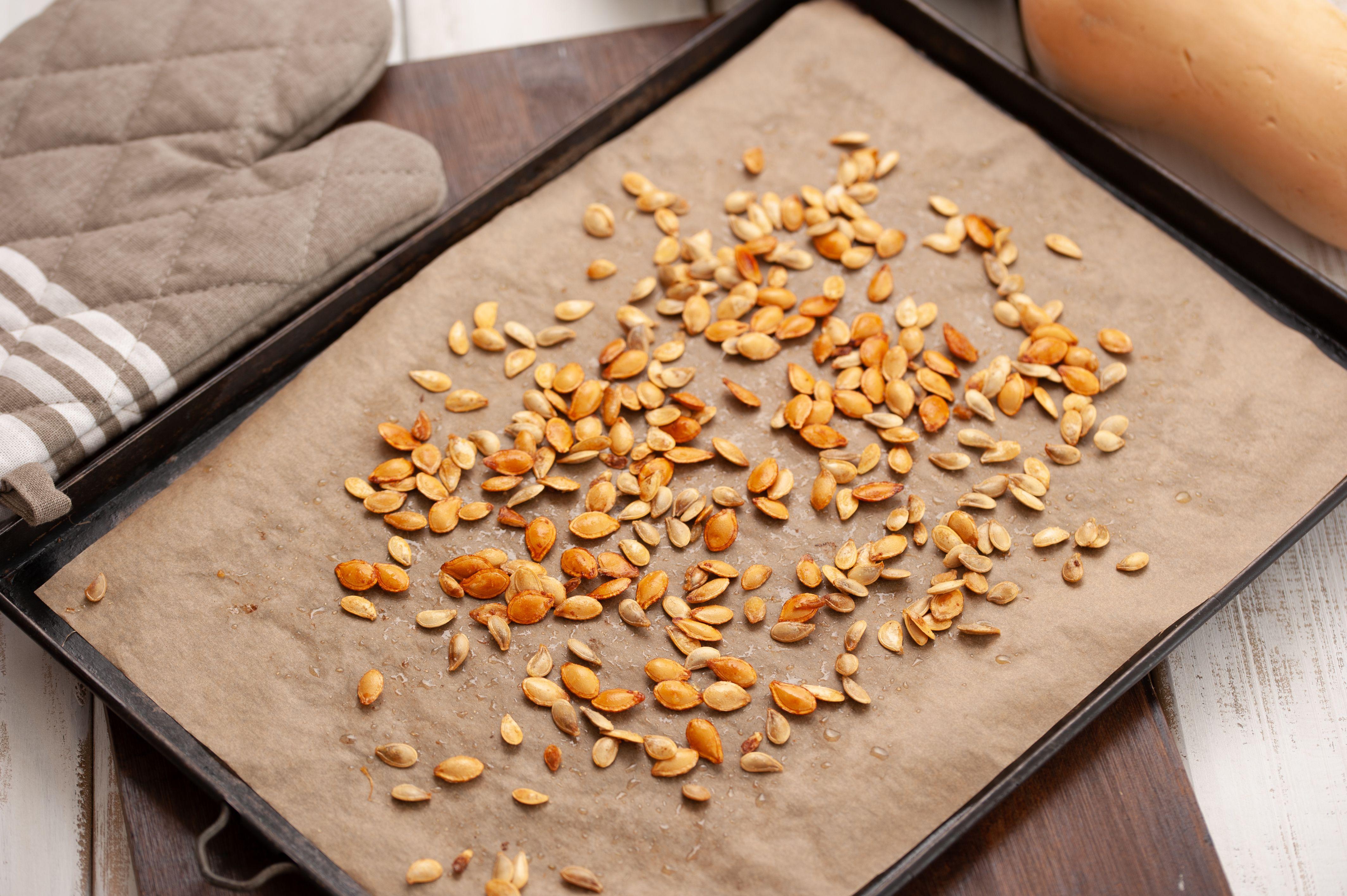 Shake the pan to loosen seeds