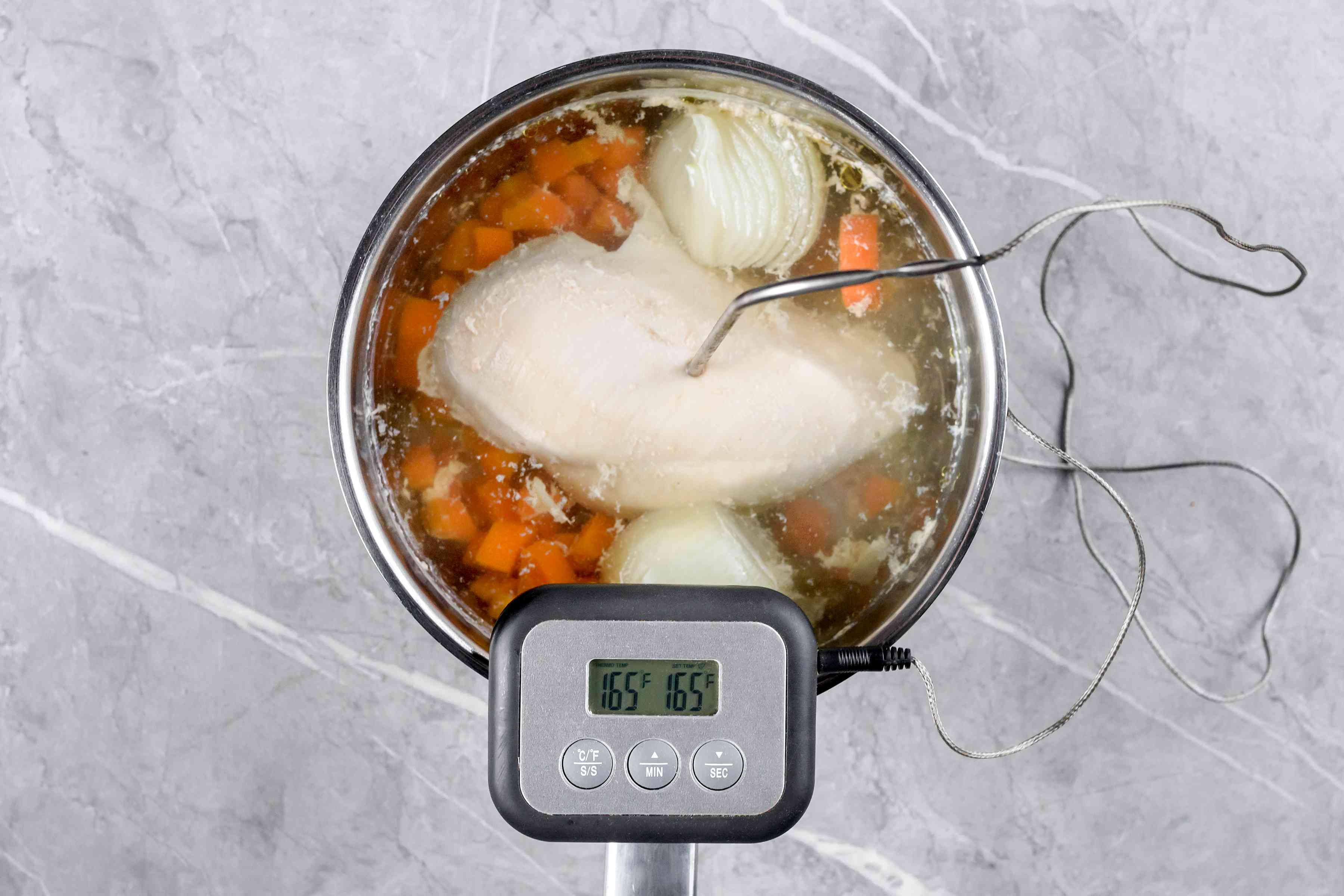 Check the poached chicken breasts with a food thermometer
