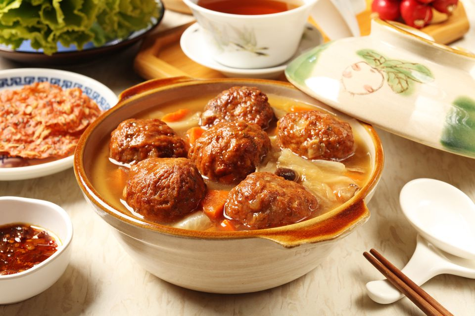 chinese lion's head meatballs in a casserole dish