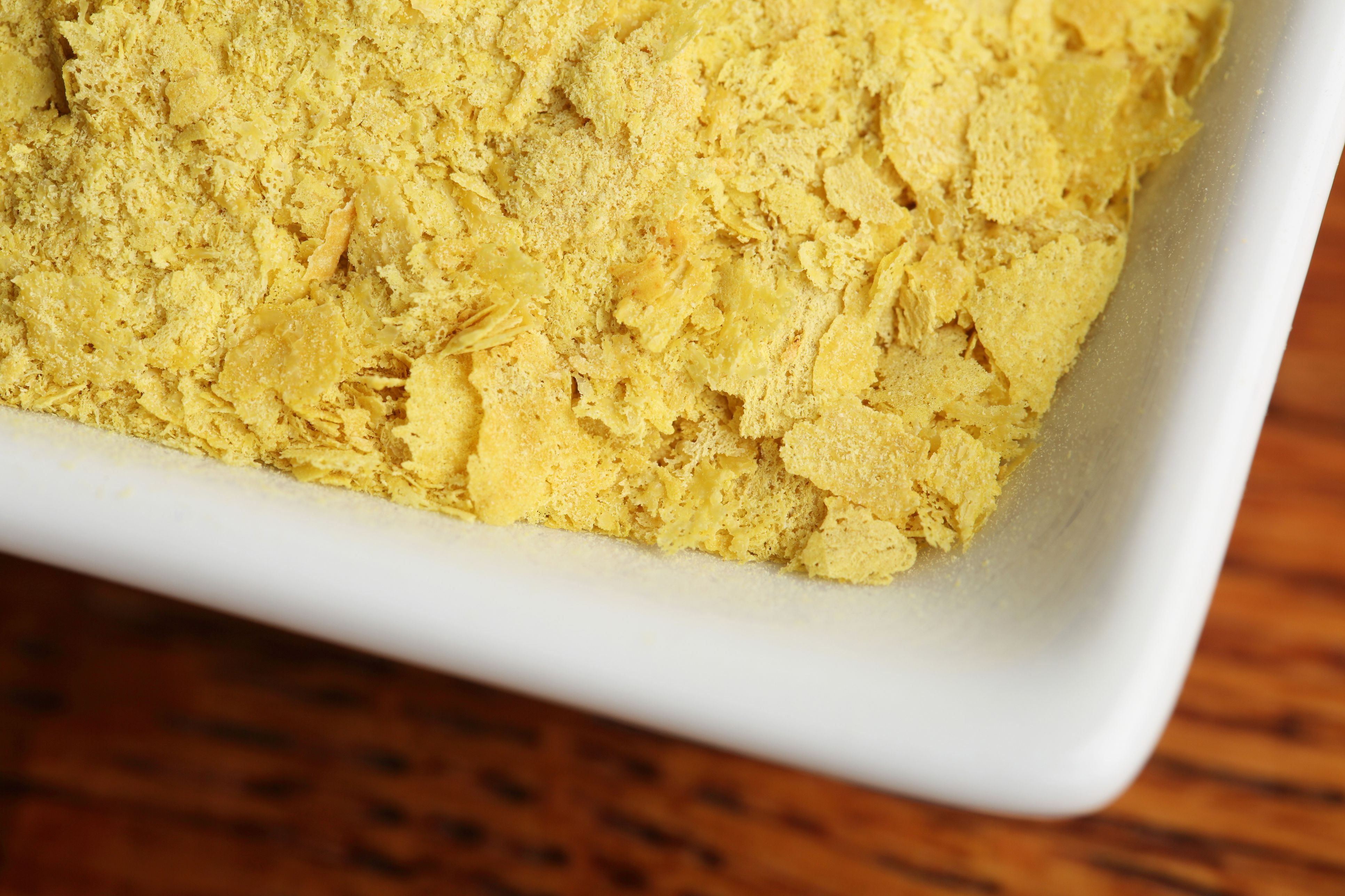 Dish of Nutritional Yeast on Wood