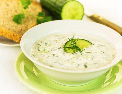 Close up of cucumber yogurt salad in white bowl