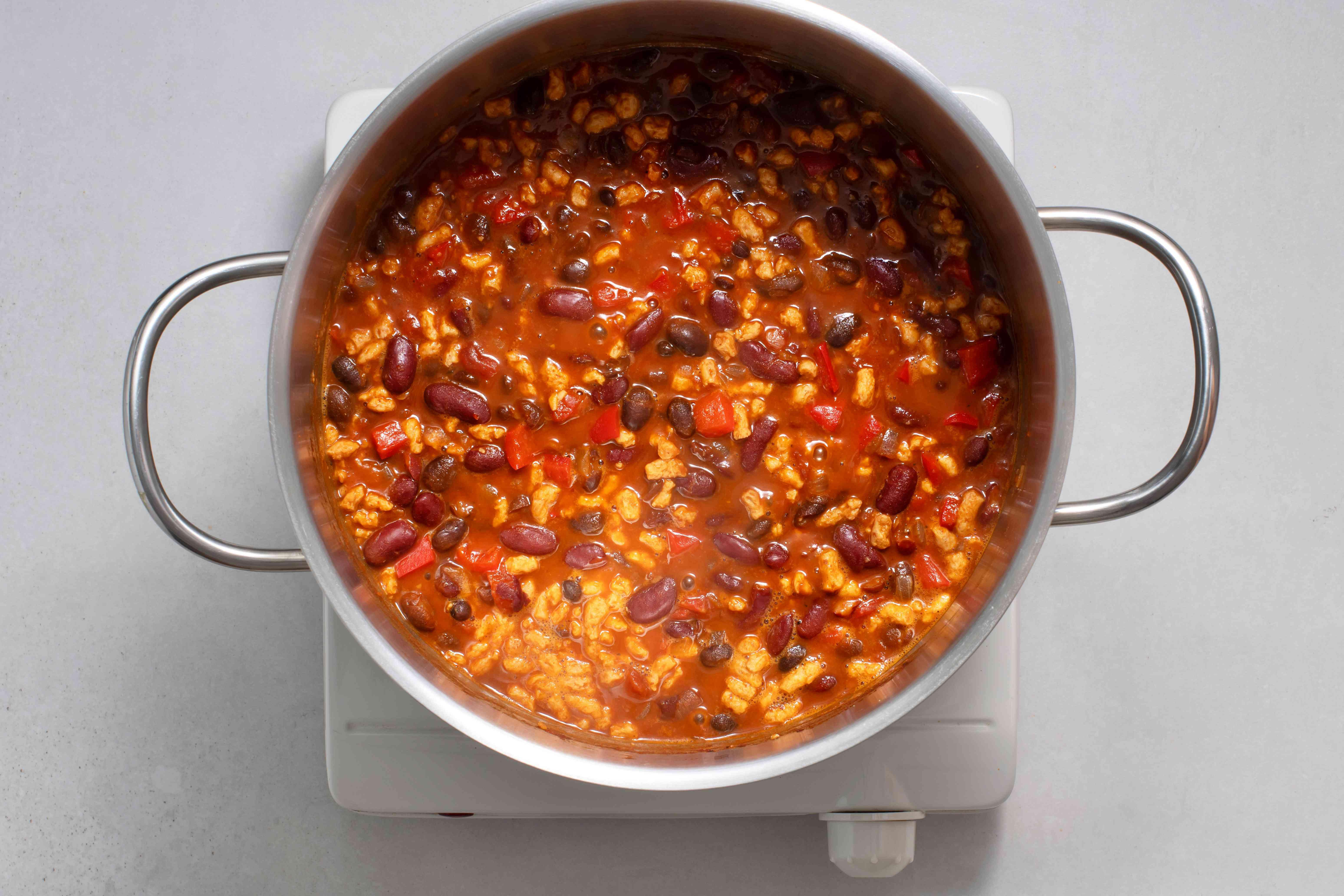TVP added to chili in the pot