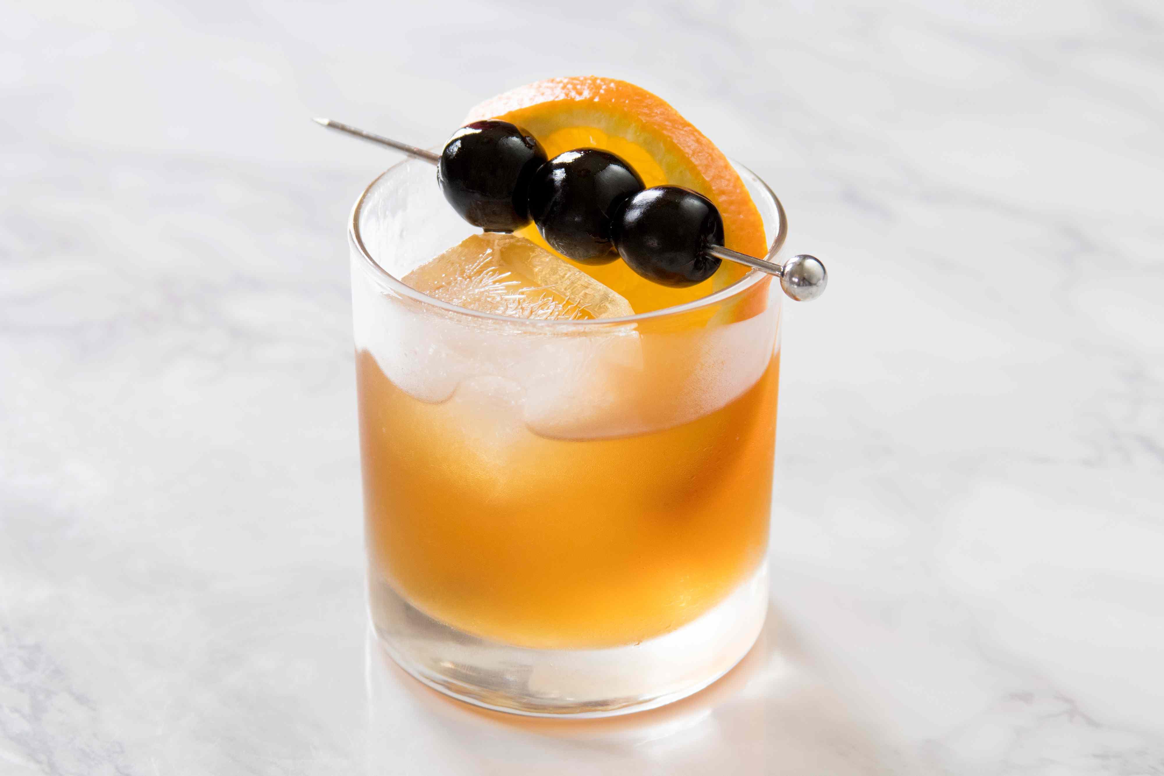 Simple Amaretto Sour With Orange and Cherry Garnish