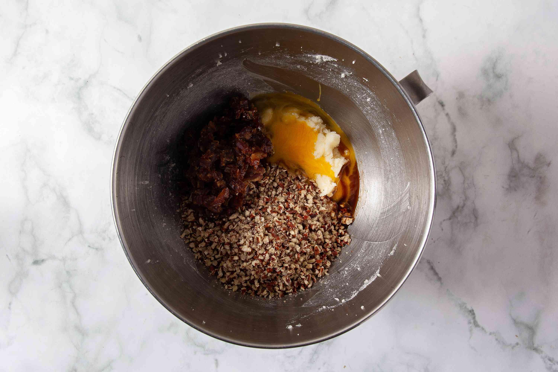 Pecan Tassies filling ingredients in a bowl