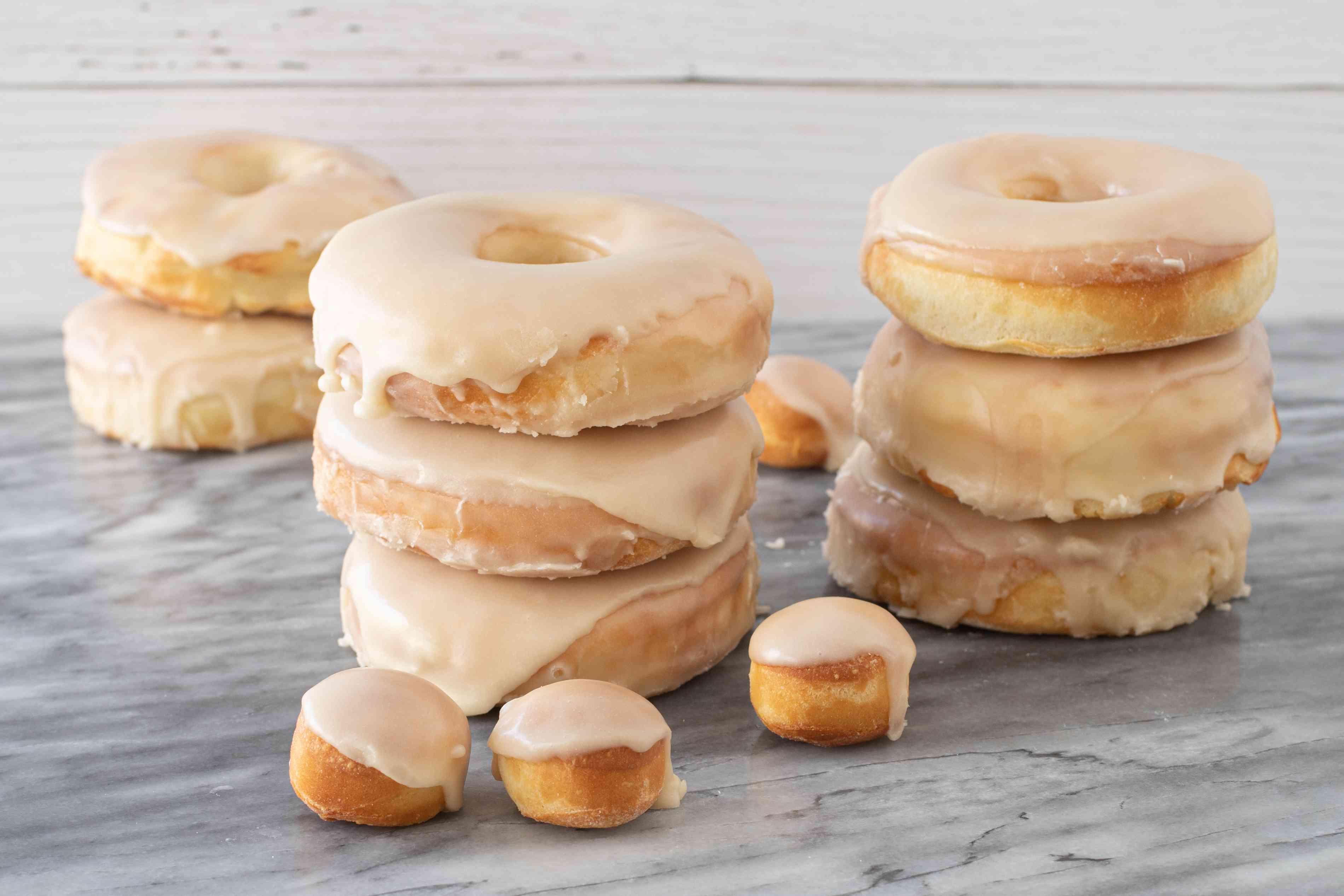 Stacks of air fryer doughnuts with vanilla glaze