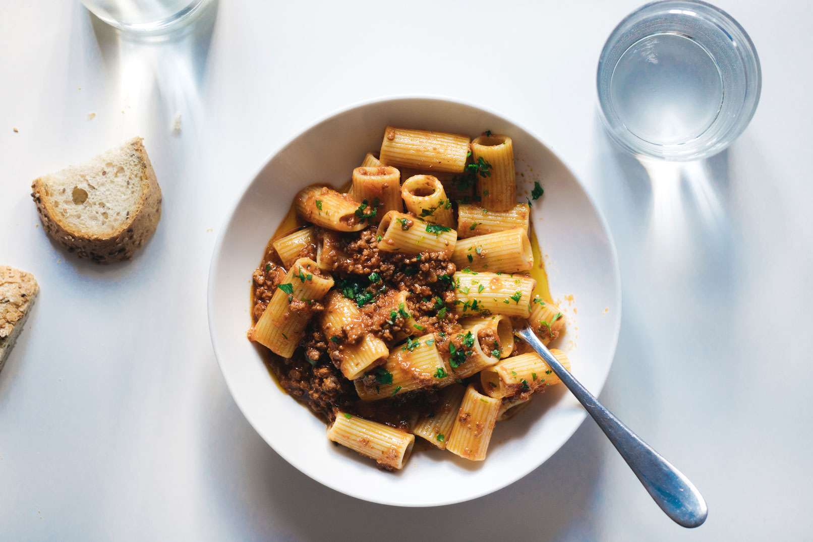A bowl of pasta topped with Bolognese sauce