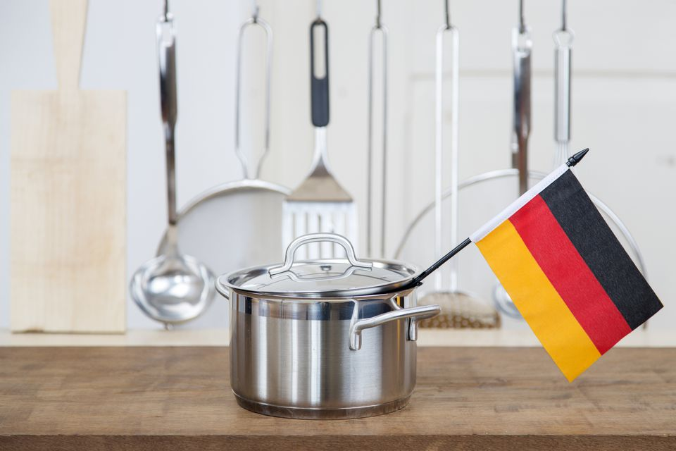 German flag sticking out of cooking pot